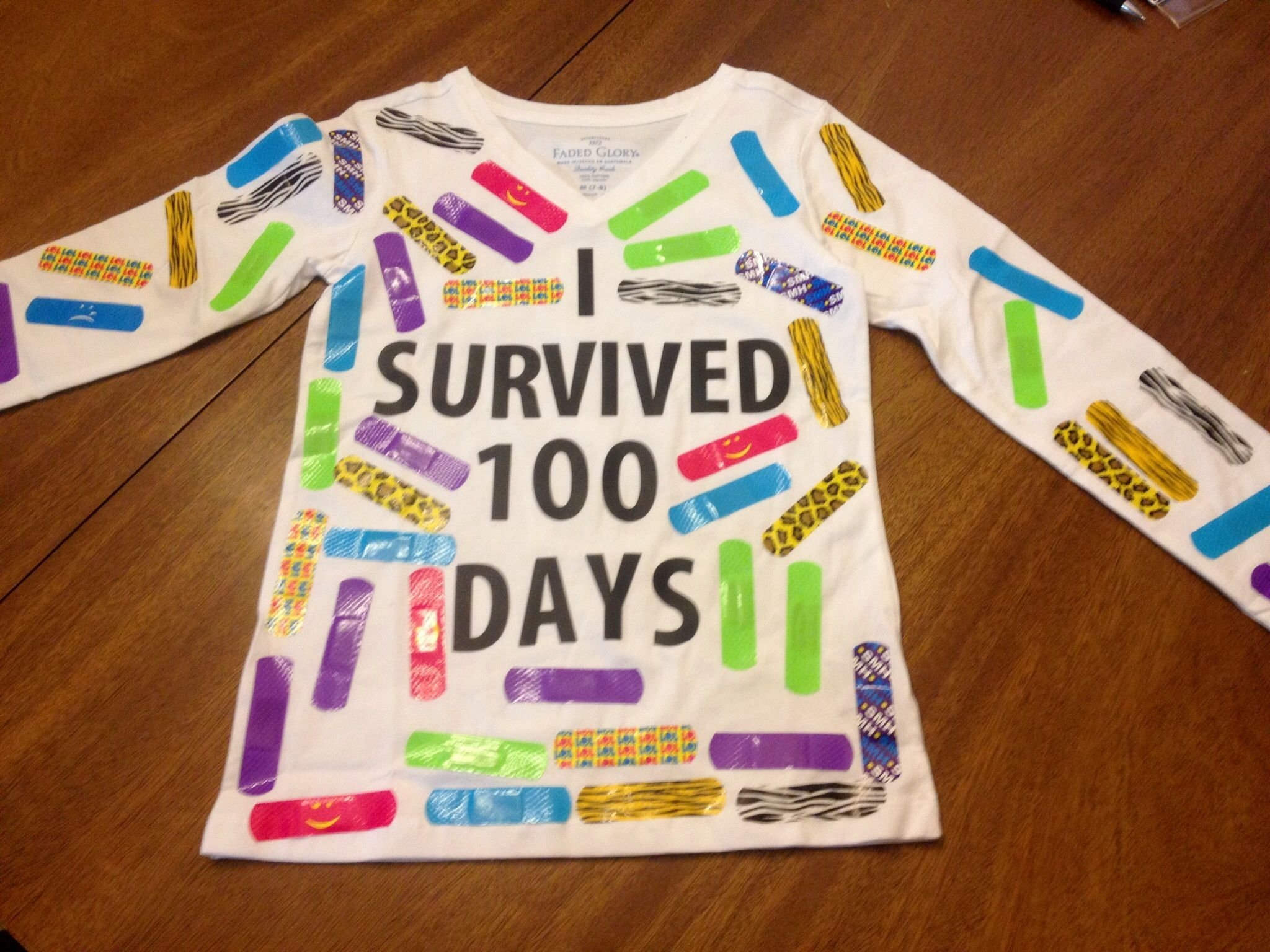 100 days of school tshirt with 100 colorful band aids. used vinyl
