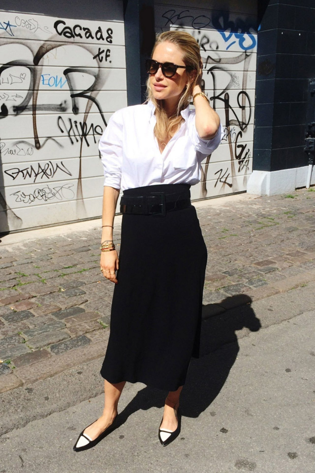 10 Awesome Long Black Skirt Outfit Ideas 18 chic ways to wear your white button down shirt this fall glamour 2020