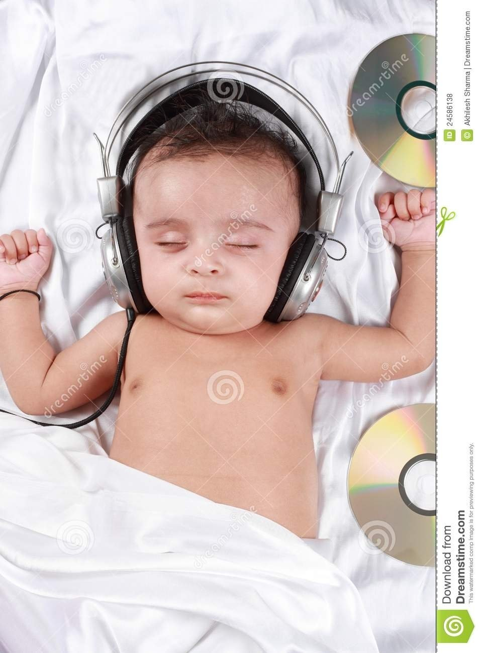 2 month old baby listening to music stock photo - image of indian