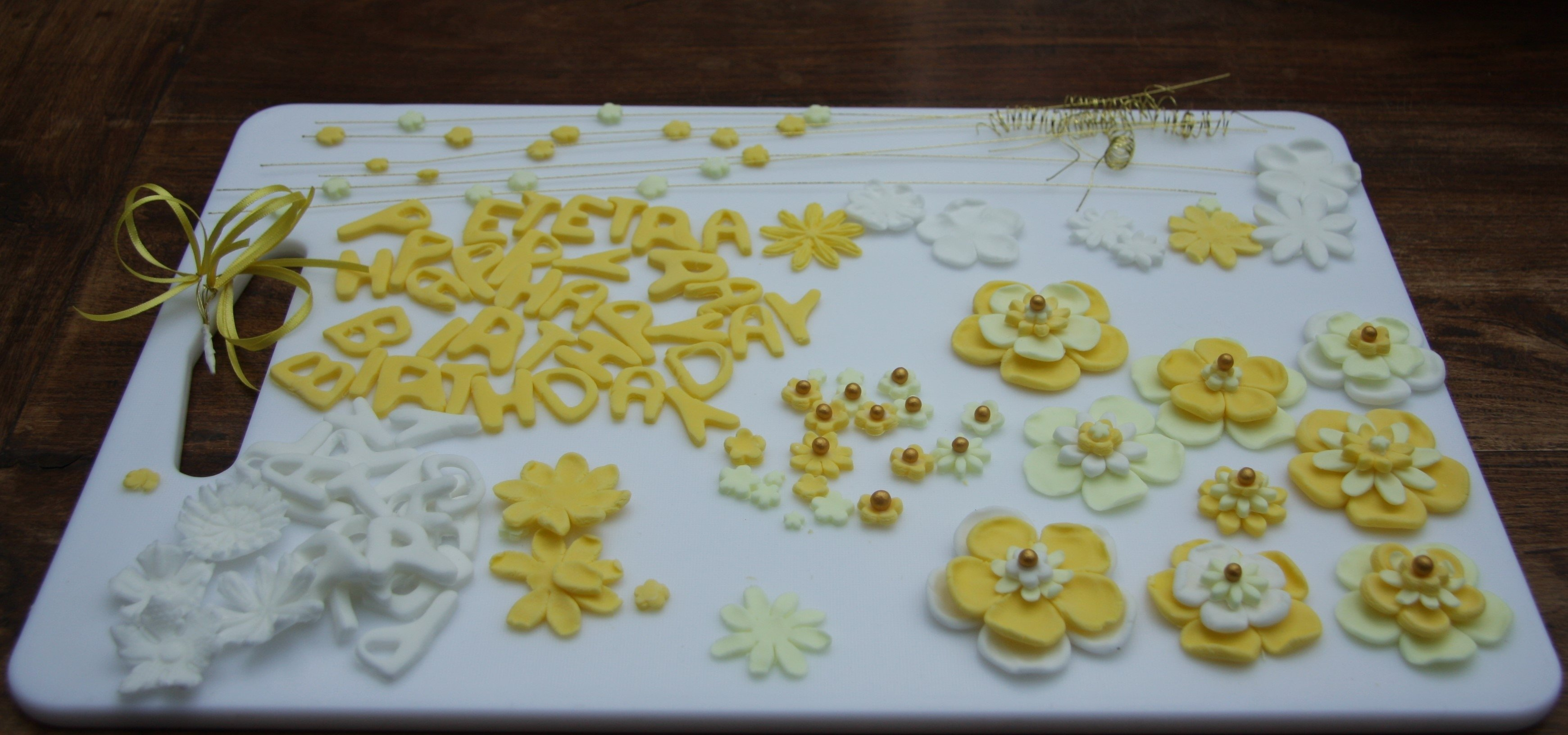 10 Awesome 50Th Birthday Cake Decorating Ideas 50th birthday cake with yellow flowers lovinghomemade 2020