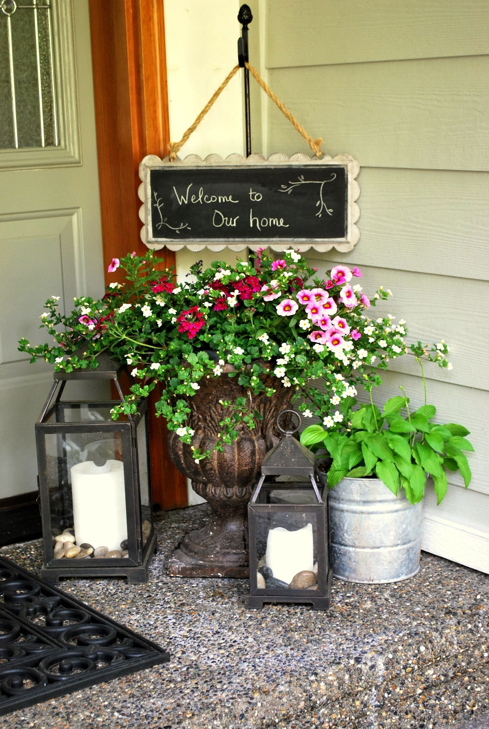 10 Fashionable Flower Pot Ideas For Front Porch a gathering place front porches porch and gardens 2021