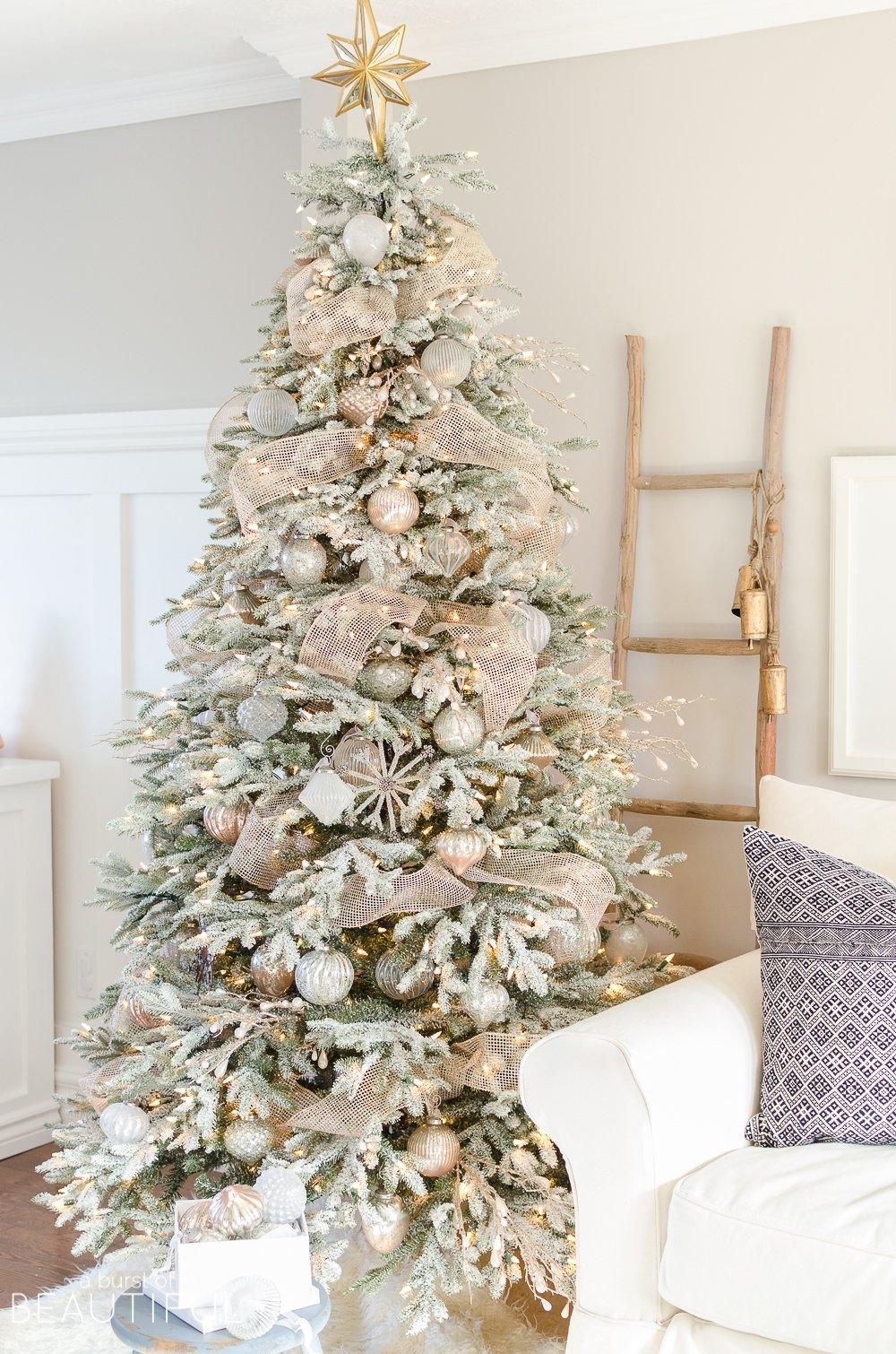10 Elegant Flocked Christmas Tree Decorating Ideas a snowy flocked christmas tree christmas tree decorating ideas