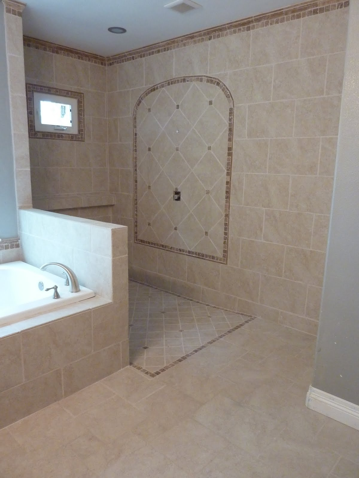 10 Spectacular Doorless Walk In Shower Ideas add glass on wall between tub and shower lip on shower entry from