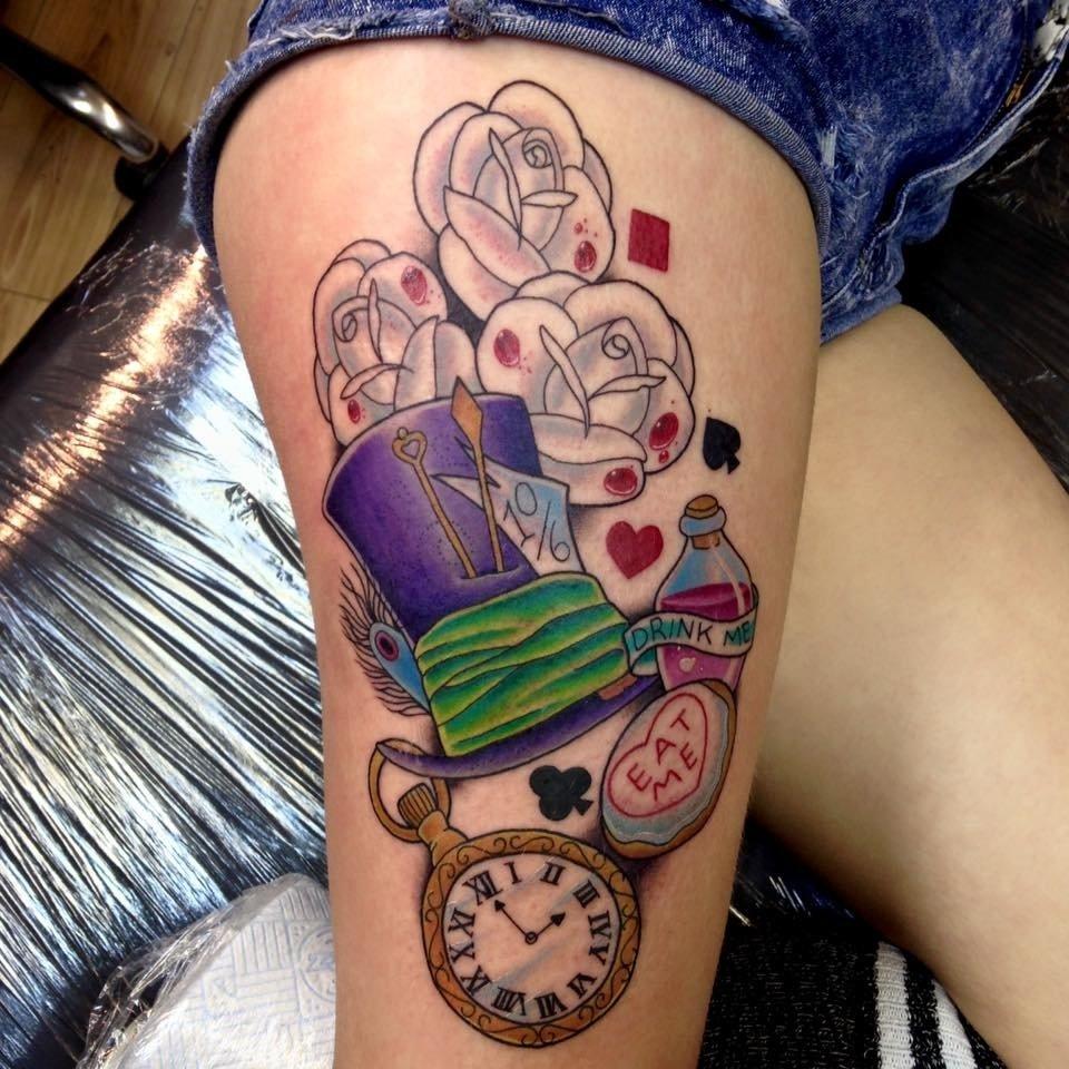 10 Trendy Alice In Wonderland Tattoo Ideas alice in wonderland tattoo on thighholly 1 2021