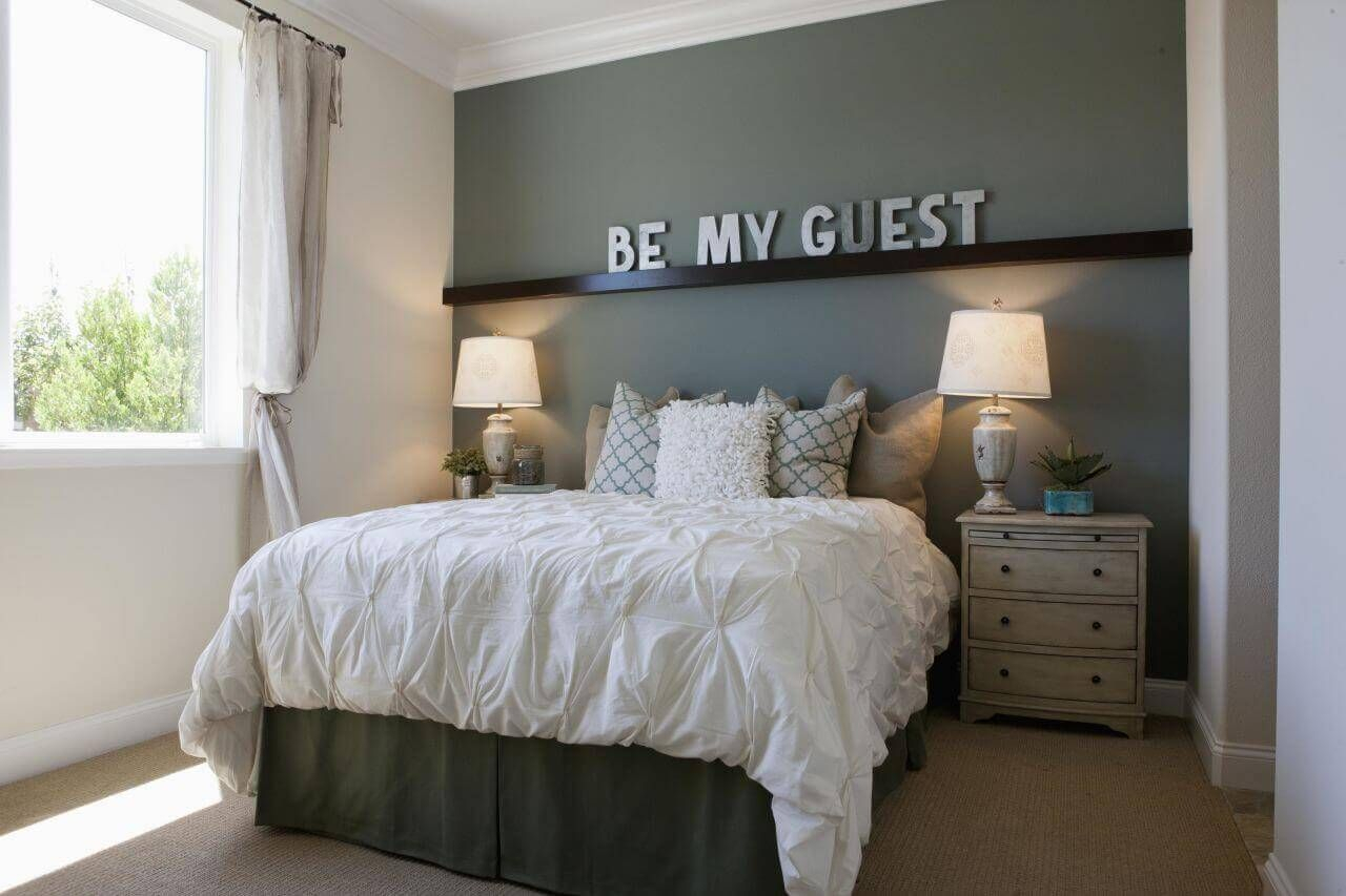an instant way to add a personal touch to any small guest room is to
