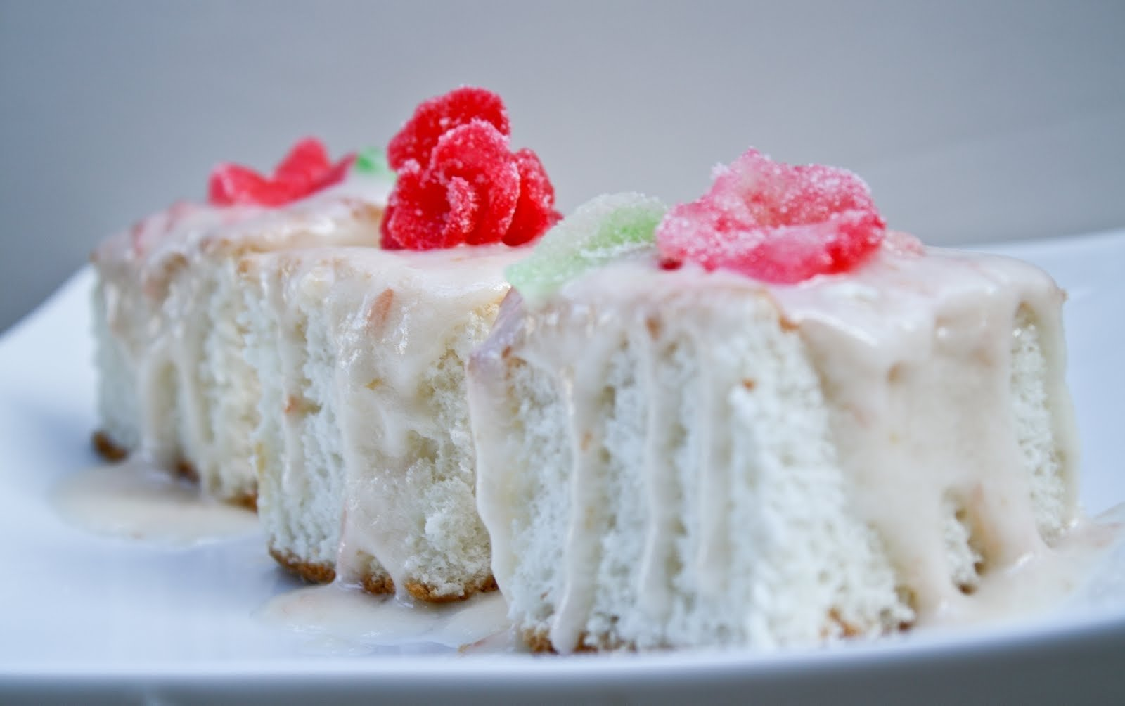 10 Attractive Angel Food Cake Topping Ideas angel food cake with pink grapefruit cream cheese icing sprinkled 2020