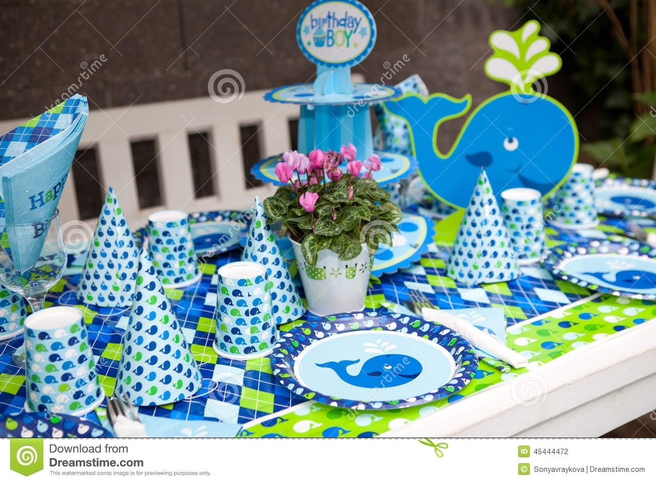 10 Fabulous Baby Boy First Birthday Party Ideas baby boy first birthday party outdoor table set stock photo 2020