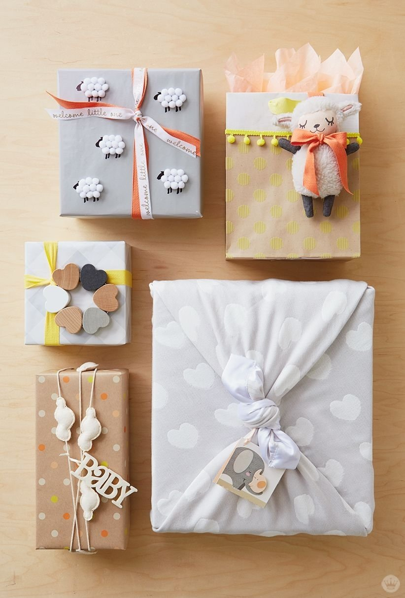 baby gift wrap ideas: showered with love | lambs, garlands and wraps