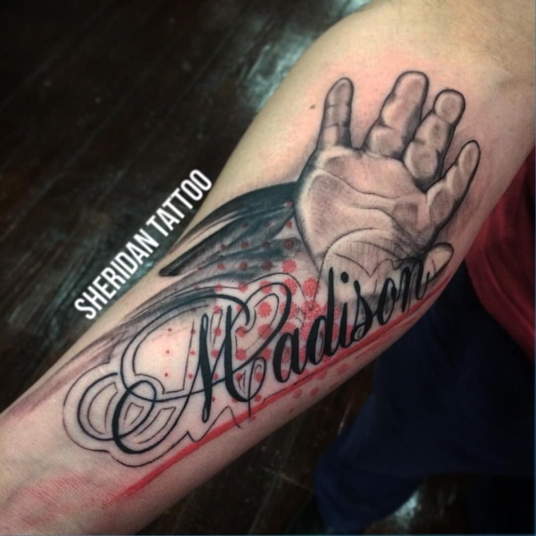 10 Beautiful Tattoo Ideas For Baby Boy baby hand with madison name tattoo design for forearm laura name 2020