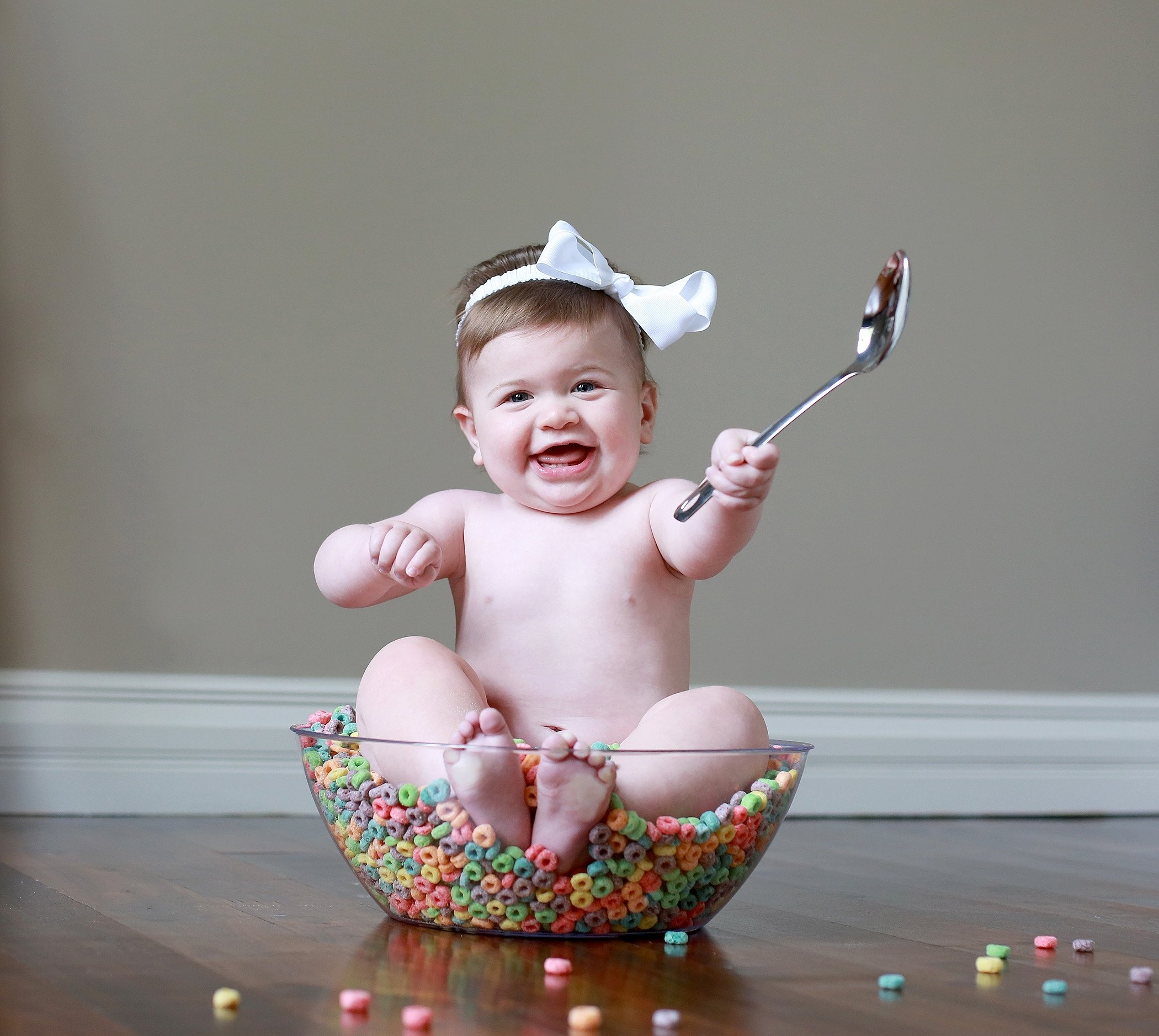 10 Stunning 6 Month Old Photo Ideas baby in a bowl of cereal sitter session ideas 6 month old baby 2021