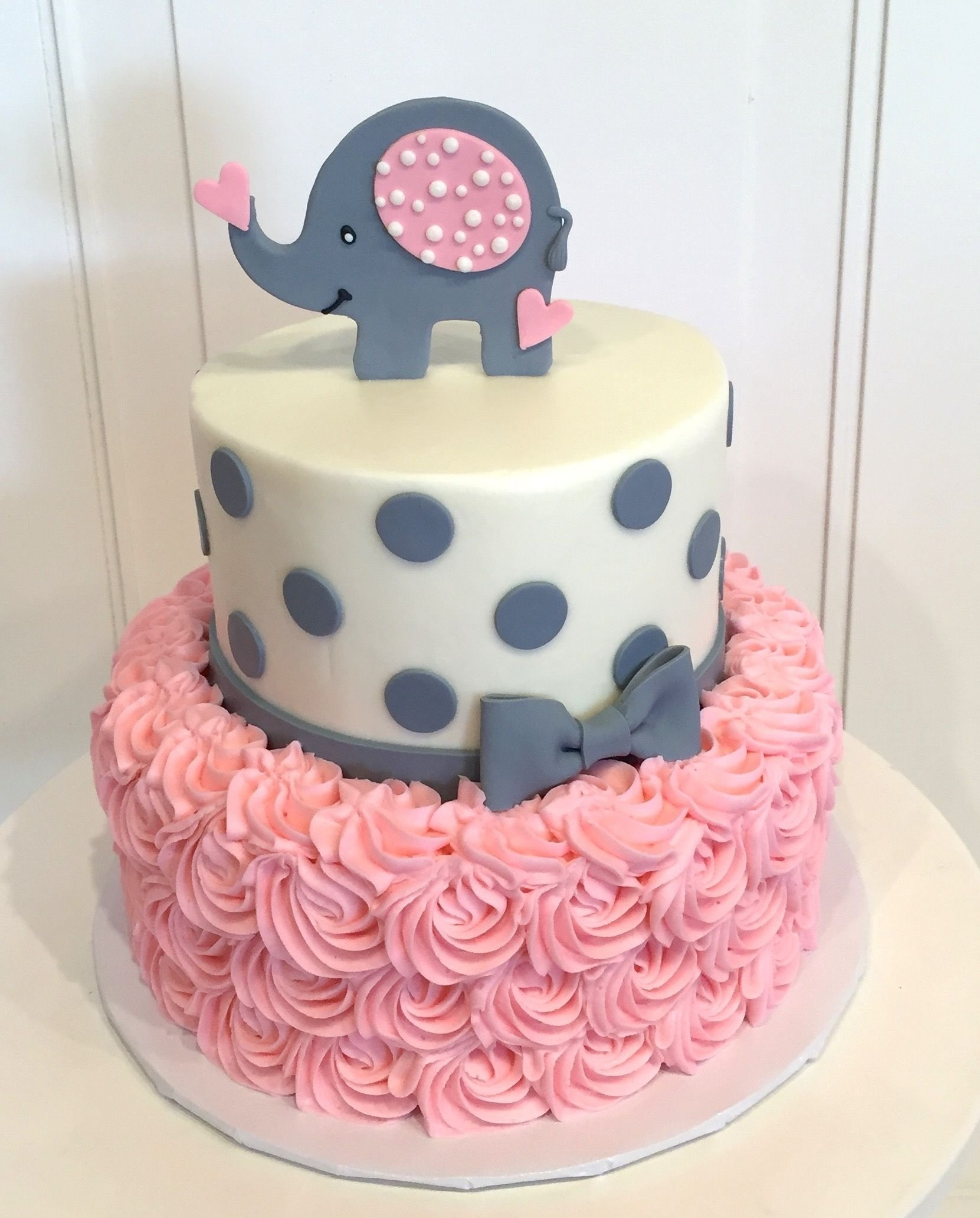 10 Stunning Baby Shower Cake Ideas For A Girl baby shower cake with elephant on top the cake is a pink rosette 1 2021