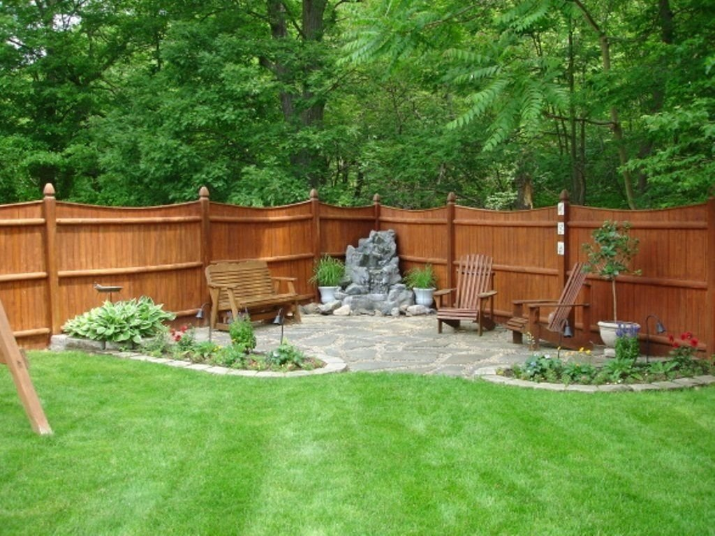 10 Ideal Backyard Decorating Ideas On A Budget backyard with wooden fences and corner patio wooden fences fences 2021