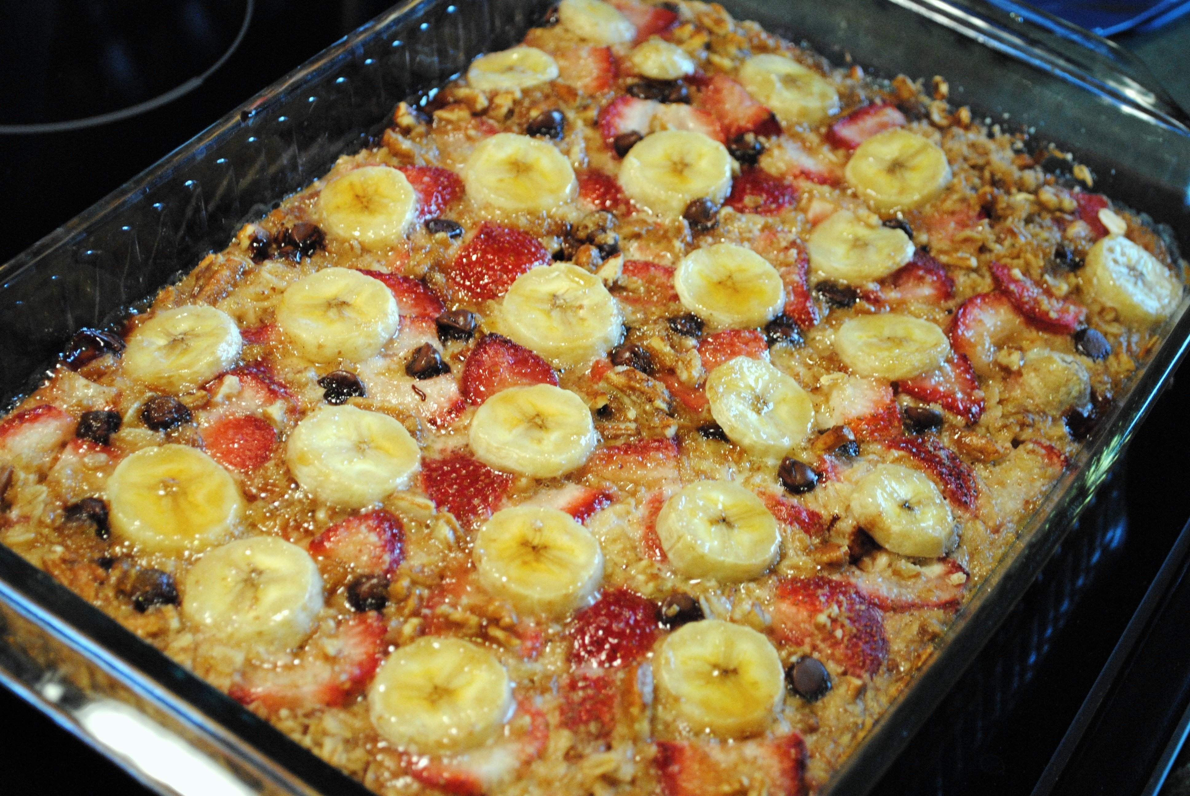 10 Stunning Breakfast Ideas For A Crowd baked oatmeal with strawberries bananas and chocolate 1 2020