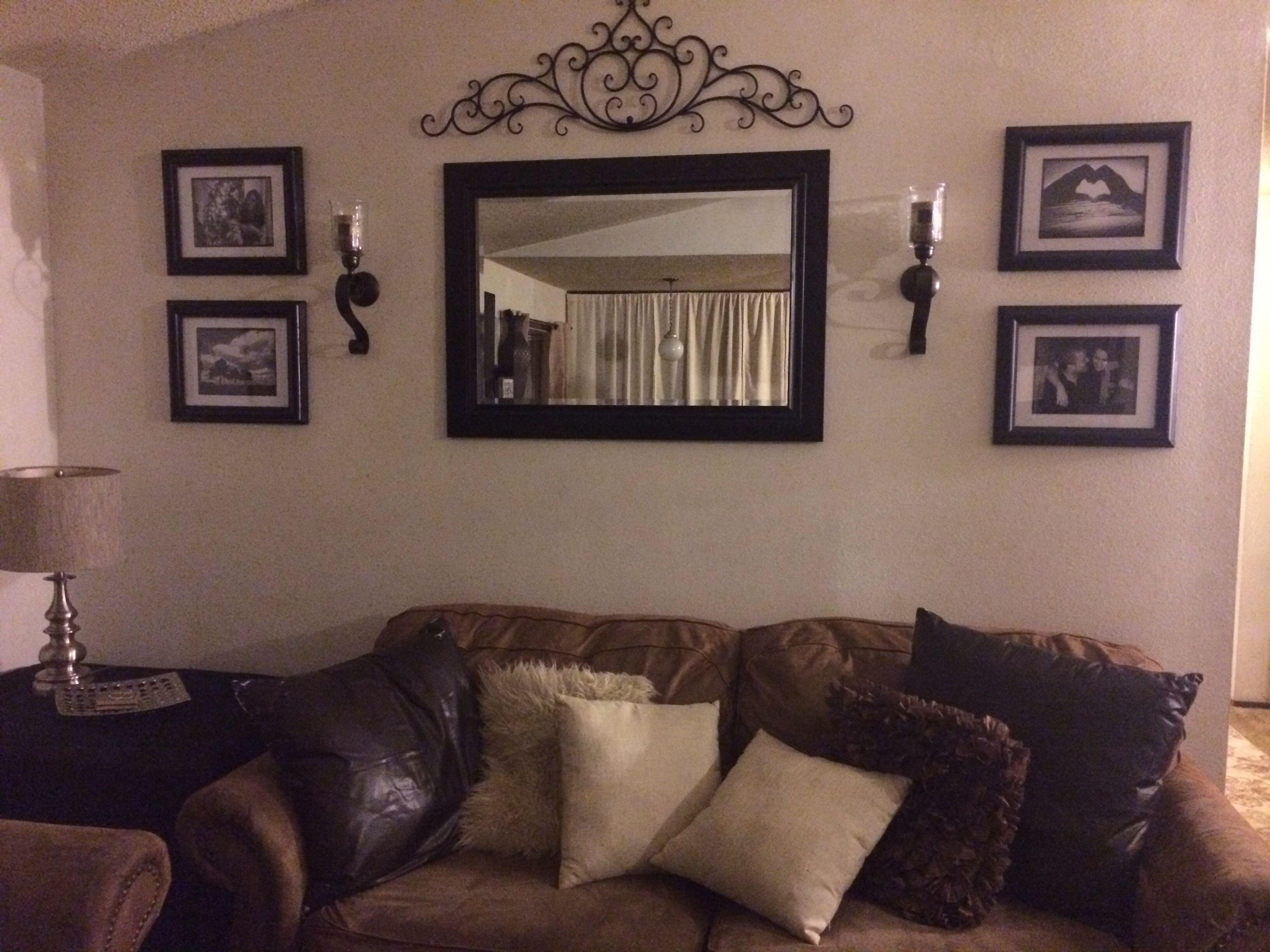 10 Famous Wall Decorating Ideas Living Room behind couch wall in living room mirror frame sconces and metal 1 2021
