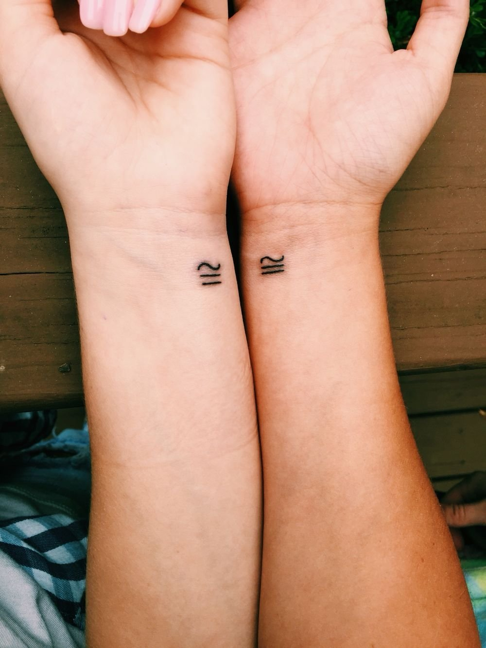 10 Great Matching Tattoo Ideas For Friends best friend tattoo congruent meaning different yet the same 2021