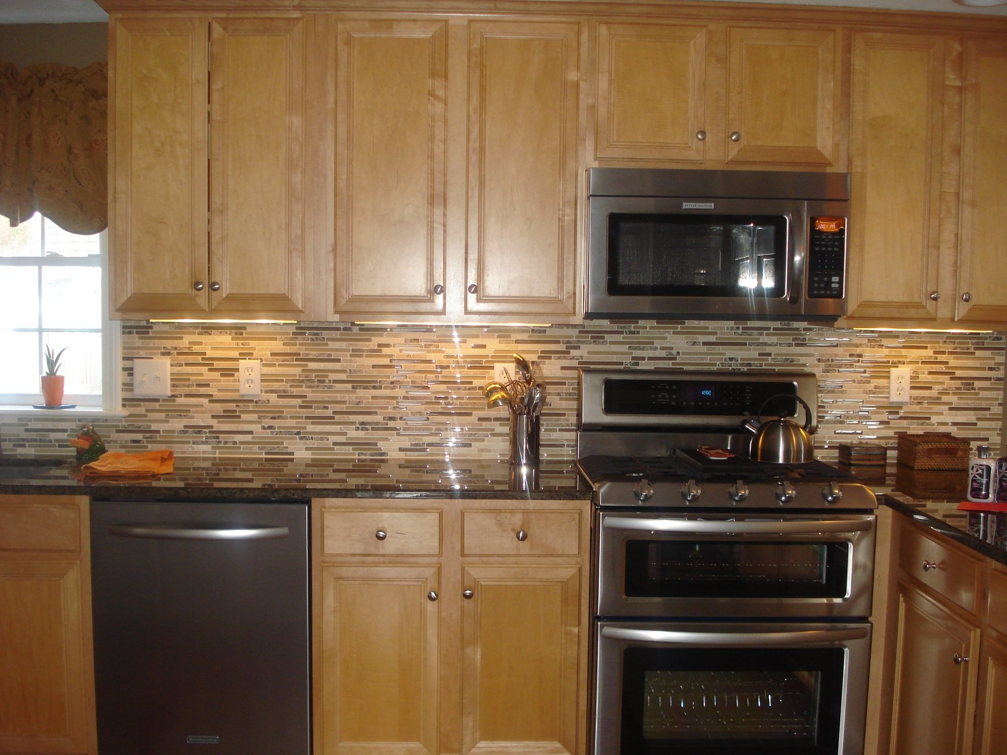 10 Gorgeous Backsplash Ideas For Black Granite Countertops black granite countertop and backsplash ideas with wooden cabinet 1 2020