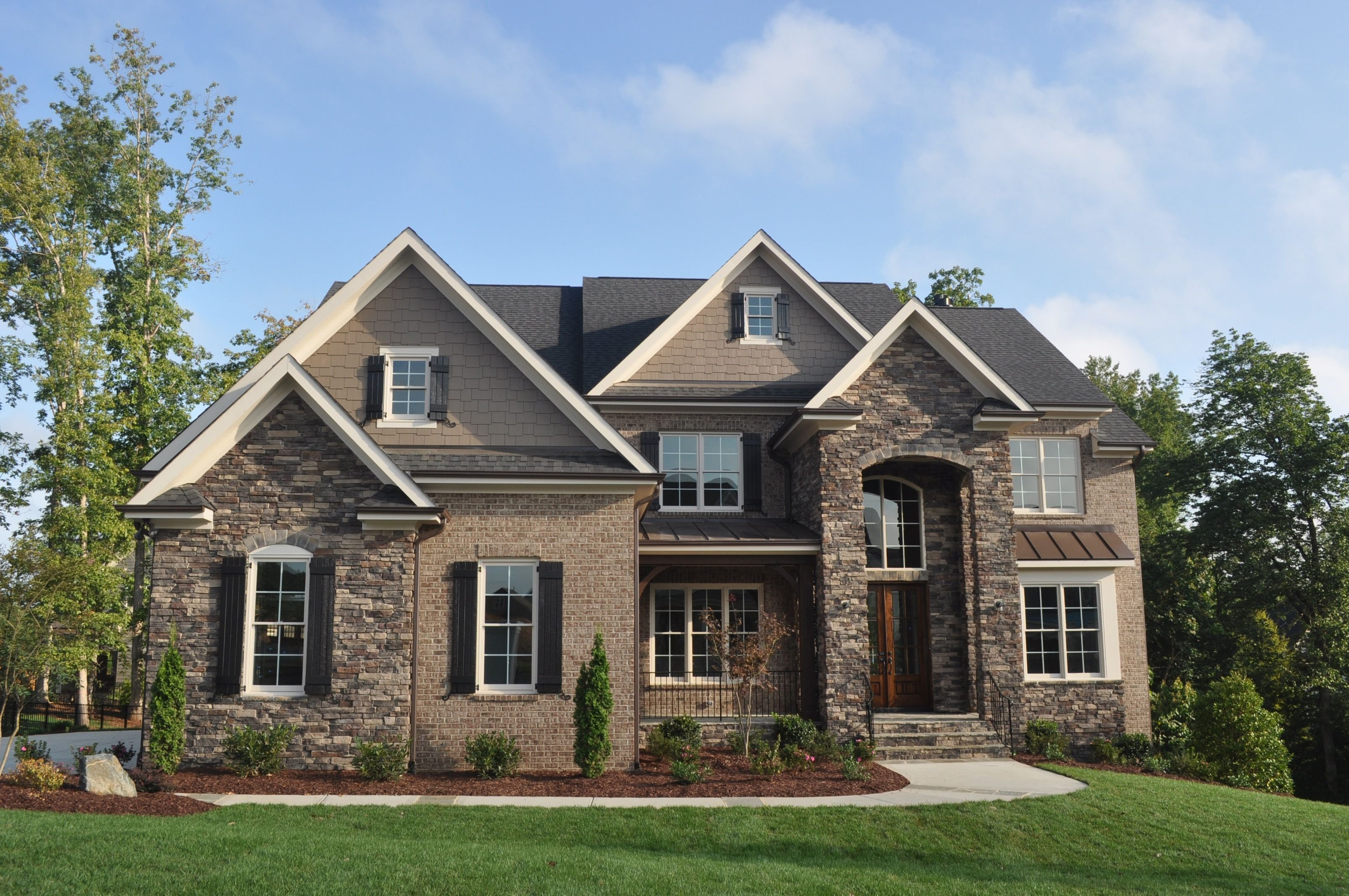 brick and stone exterior with a little siding | exterior of new home
