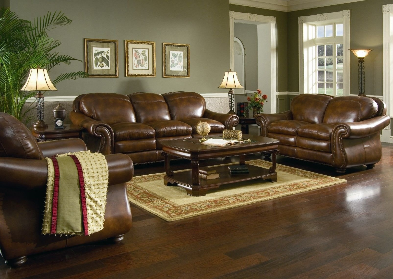 10 Gorgeous Living Room Paint Ideas With Brown Furniture brown leather sofa set for living room with dark hardwood floors 1 2021