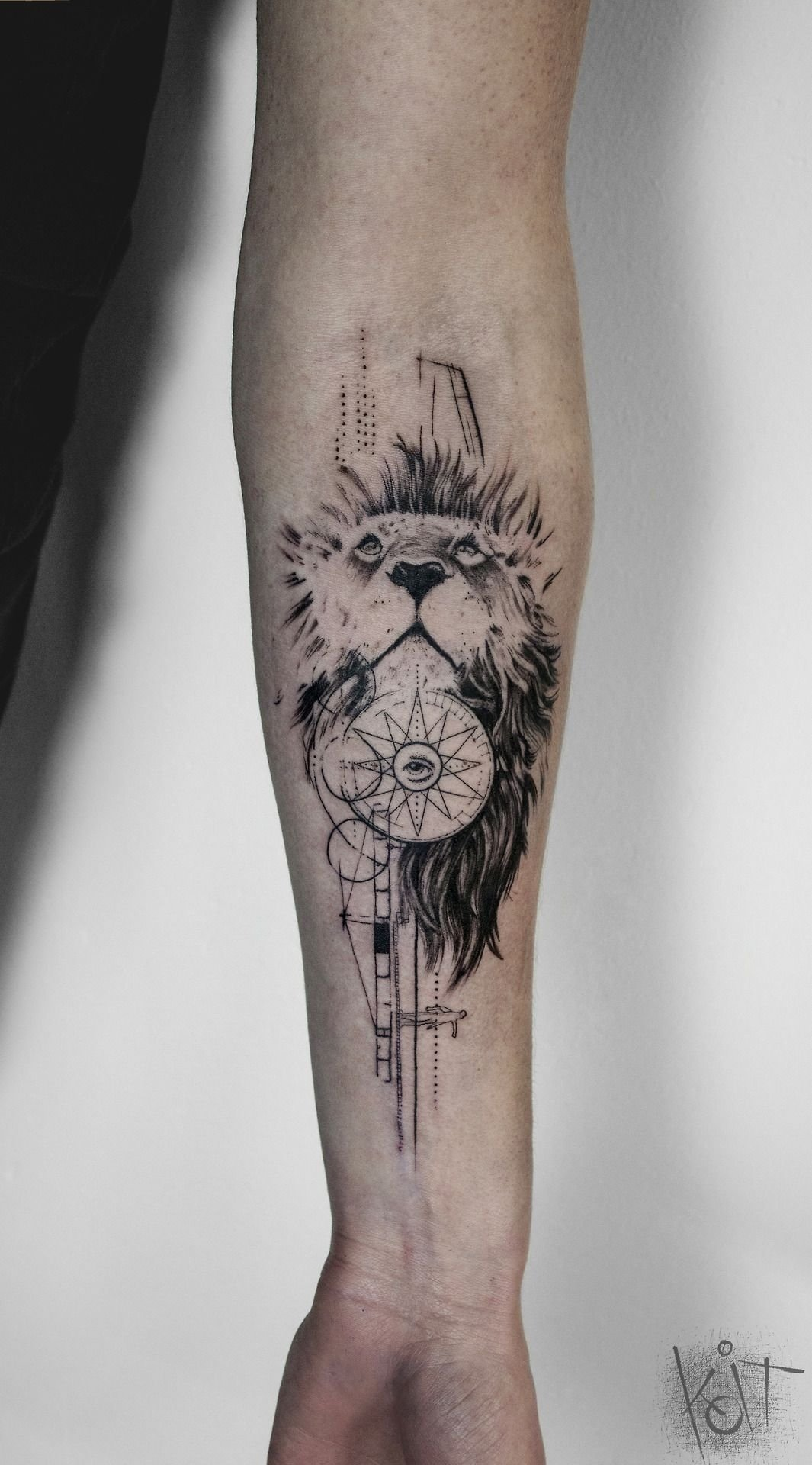 by koit, berlin. forearm black tattoo - lion, compass and illuminati