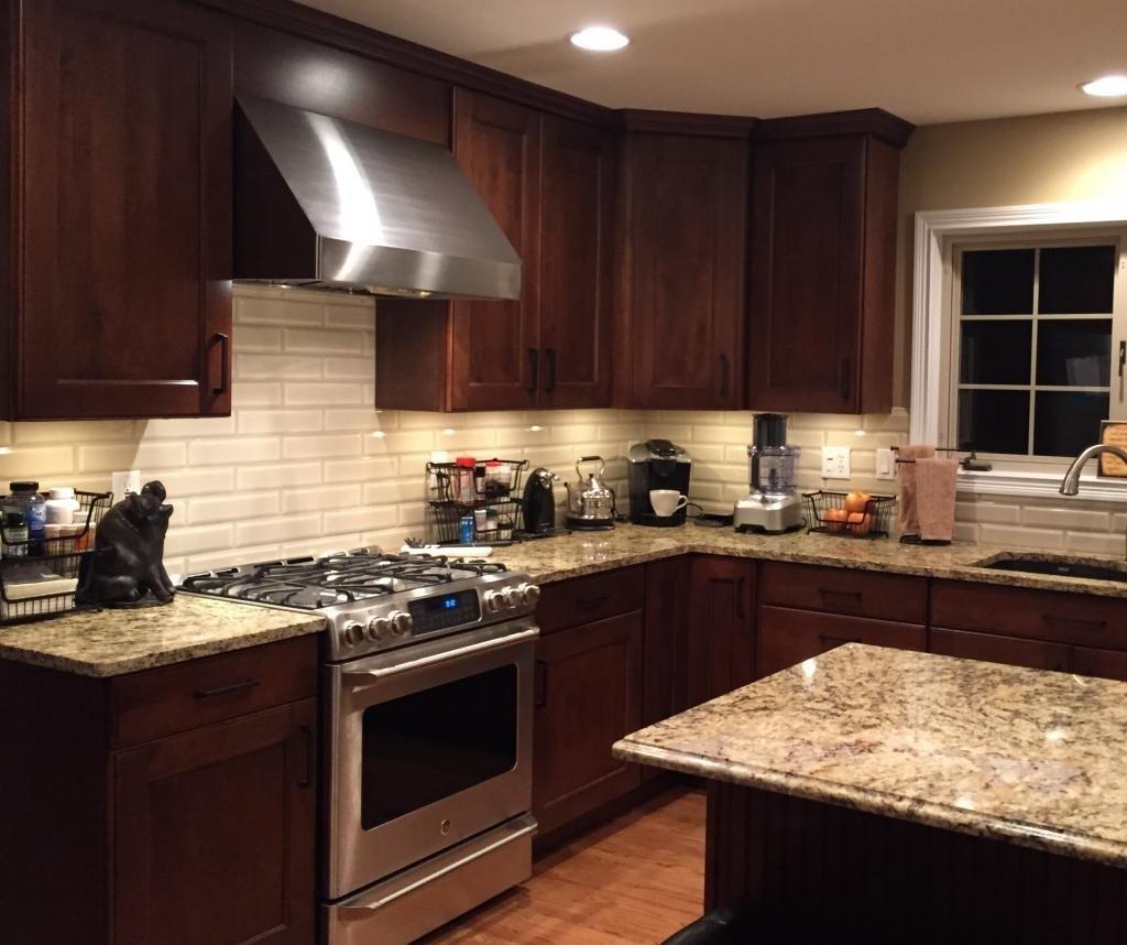 10 Amazing New Venetian Gold Granite Backsplash Ideas cabinets mid continent maple briarwood with black glaze allen 2021