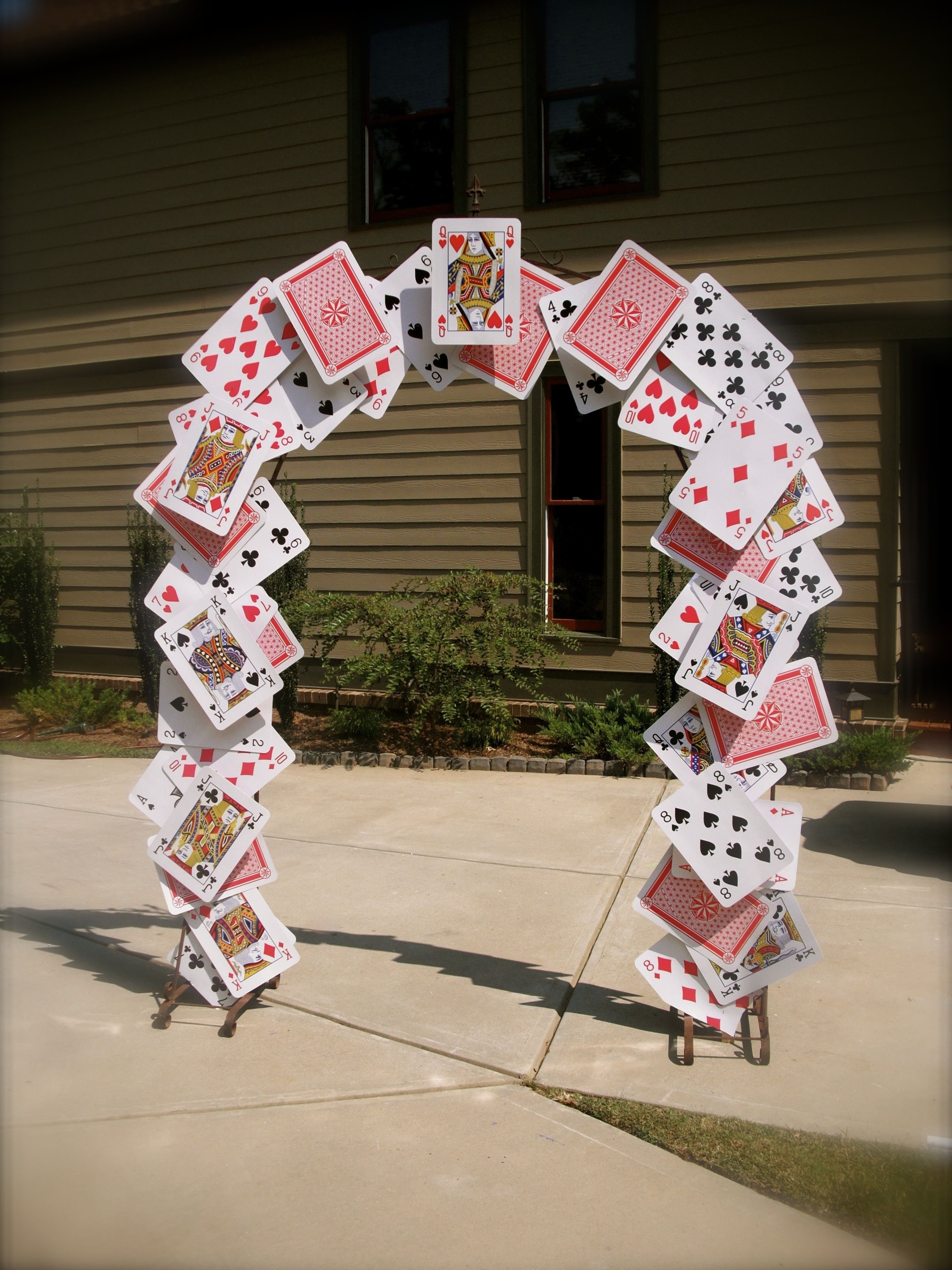 10 Stylish Alice In Wonderland Party Ideas For Adults card arch for alice in wonderland party props pinterest