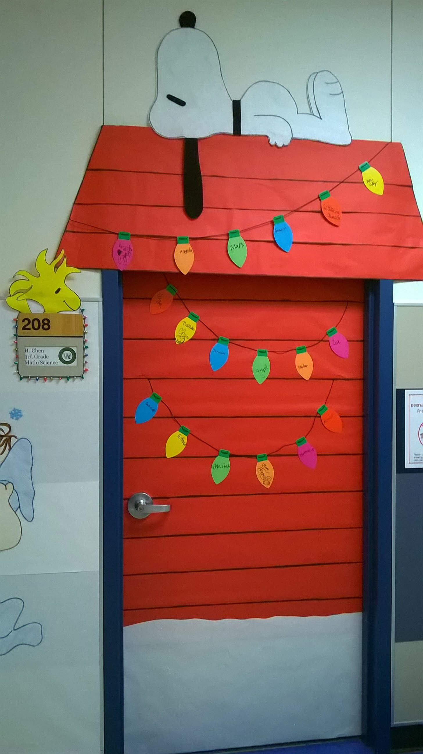 10 Perfect Christmas Classroom Door Decorating Ideas charlie brown christmas classroom door decoration love that snoopy 1 2021