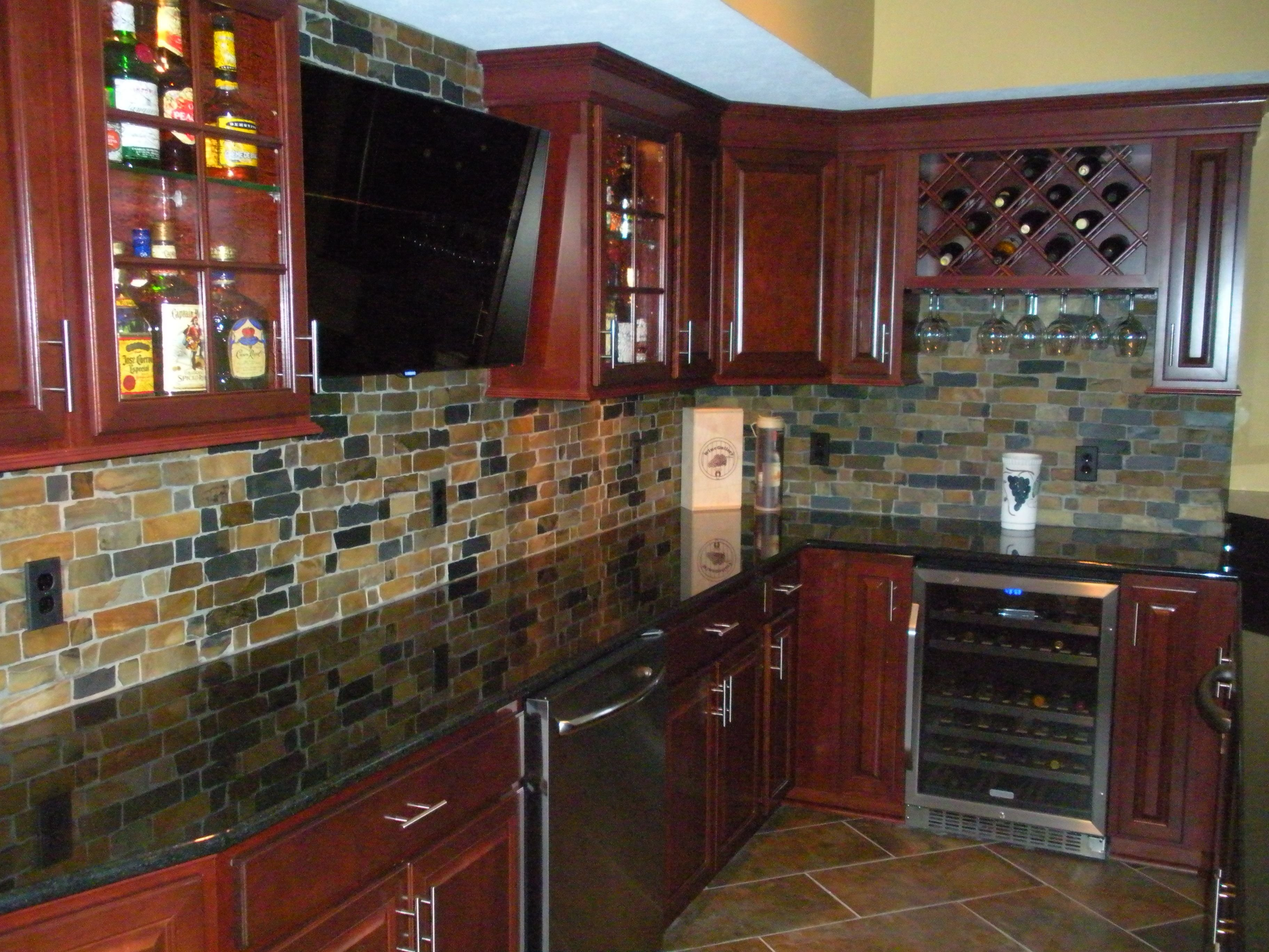 10 Attractive Backsplash Ideas For Cherry Cabinets cherry cabinets granite countertops natural slate backsplash 2021