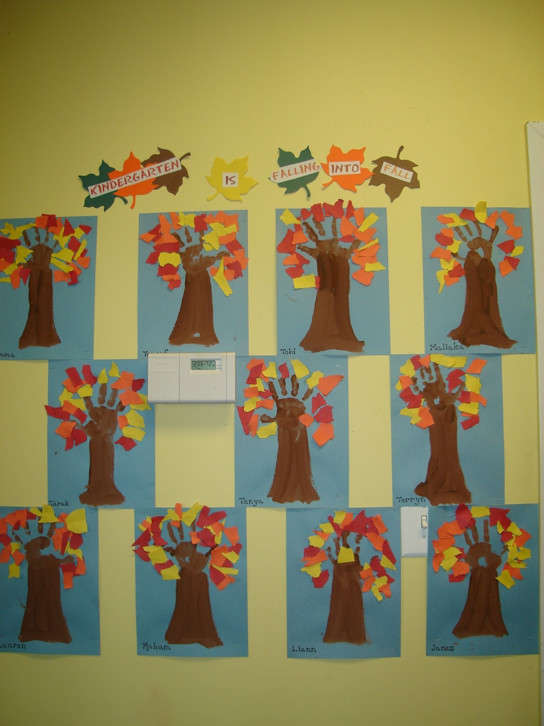 "children made the ""kindergarten is falling into fall"" display using"