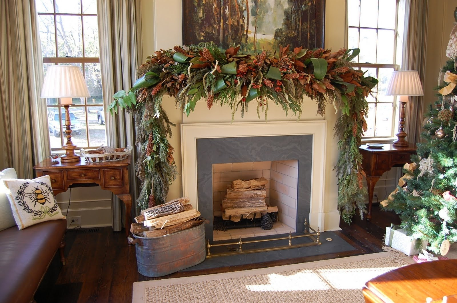 christmas mantel decorated with natural greenery in southern living