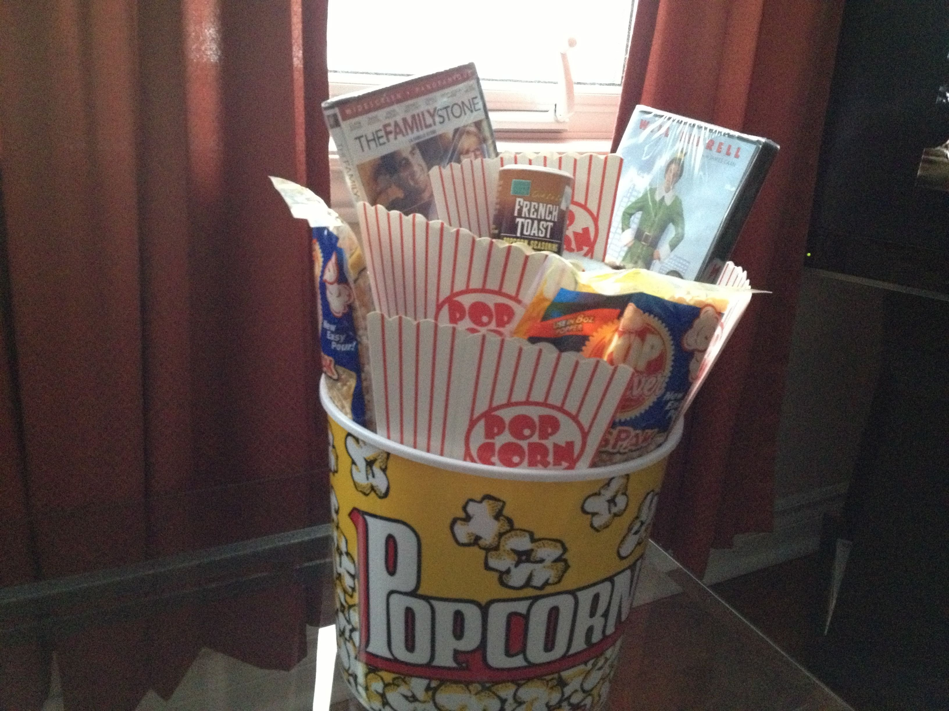 10 Lovely Gift Ideas For Gift Exchange christmas movie themed gift basket a bucket of popcorn filled with