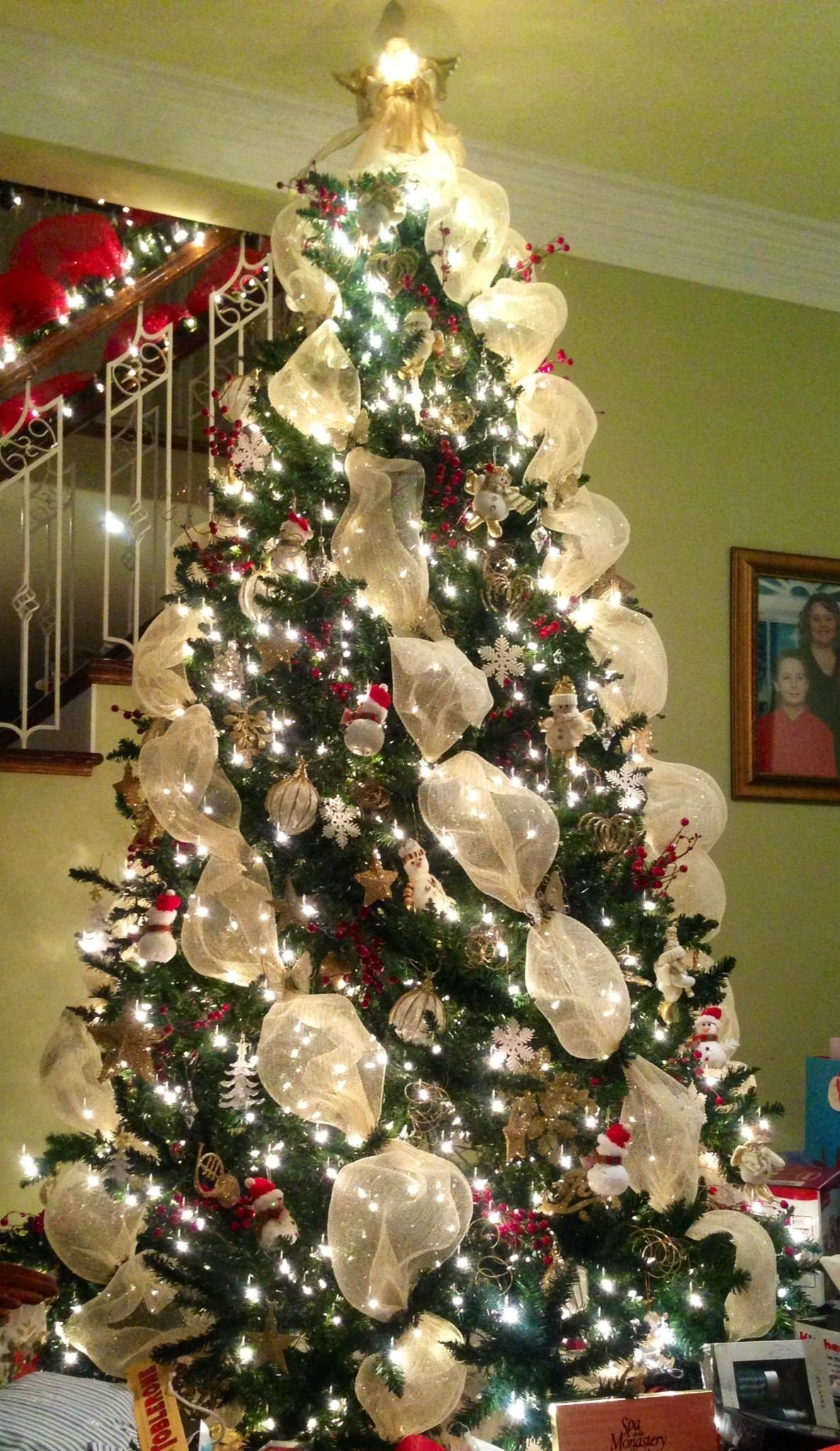 10 Spectacular Christmas Tree Decorating Ideas With Ribbon christmas tree angled gold mesh red berries gold ornaments 2021