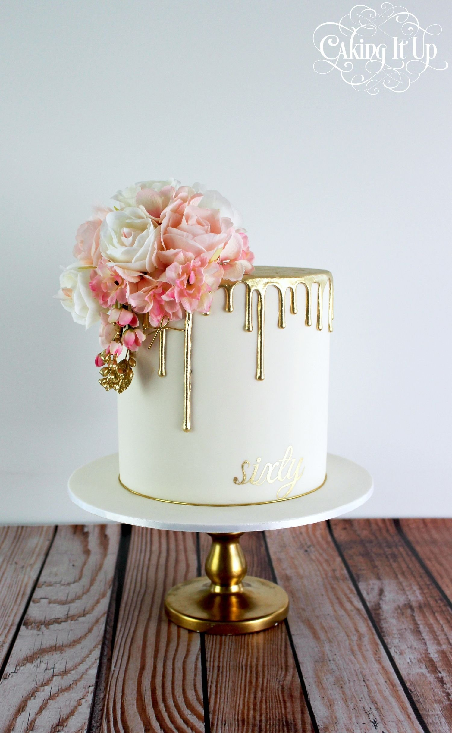 10 Awesome Birthday Cake Ideas For Women classy and elegant golden drizzle 60th birthday cake with a pretty 2020
