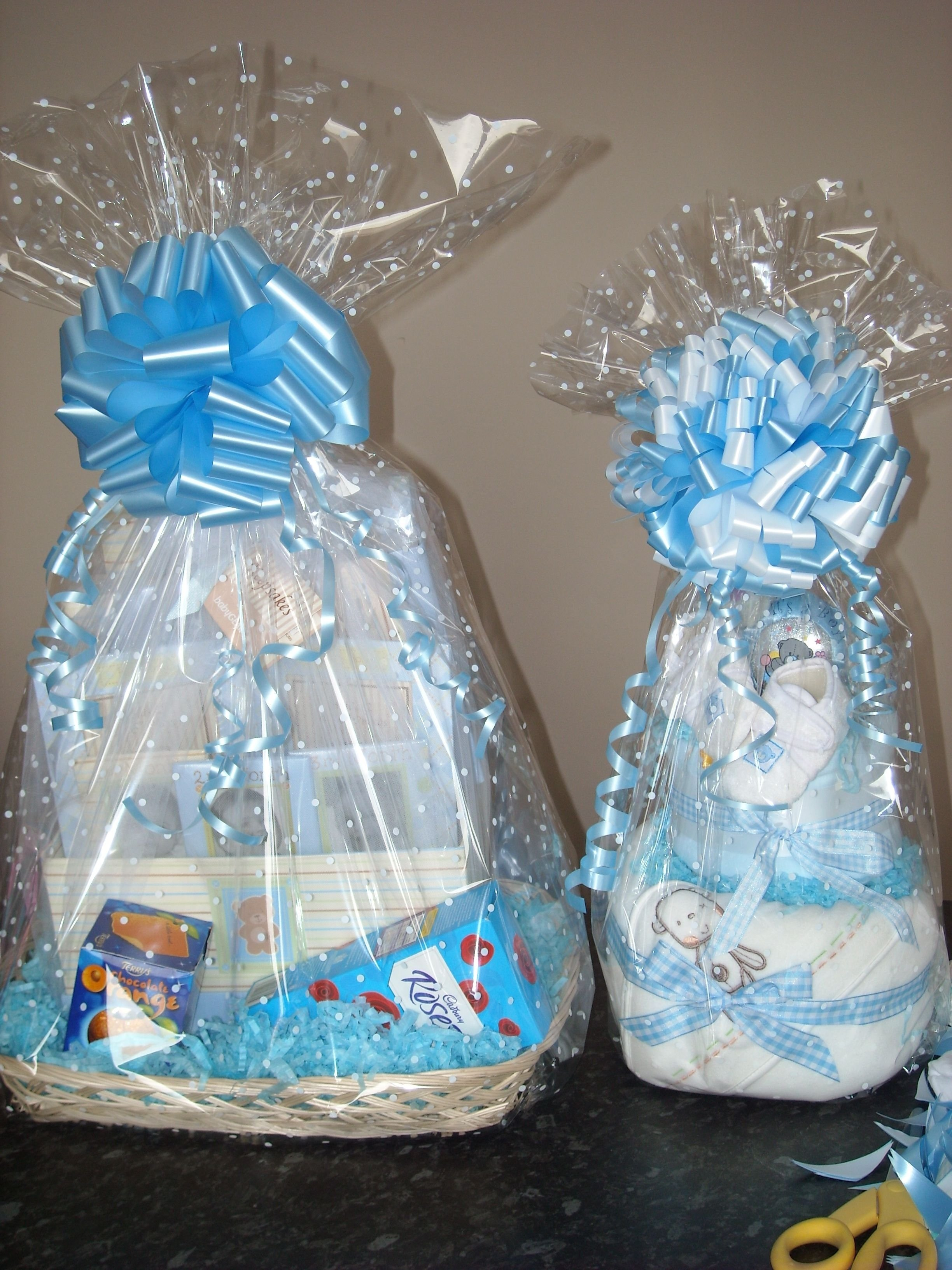 10 Attractive Baby Shower Gift Wrapping Ideas clear cellophane with a white dot for a baby shower gift wrap gift 2020