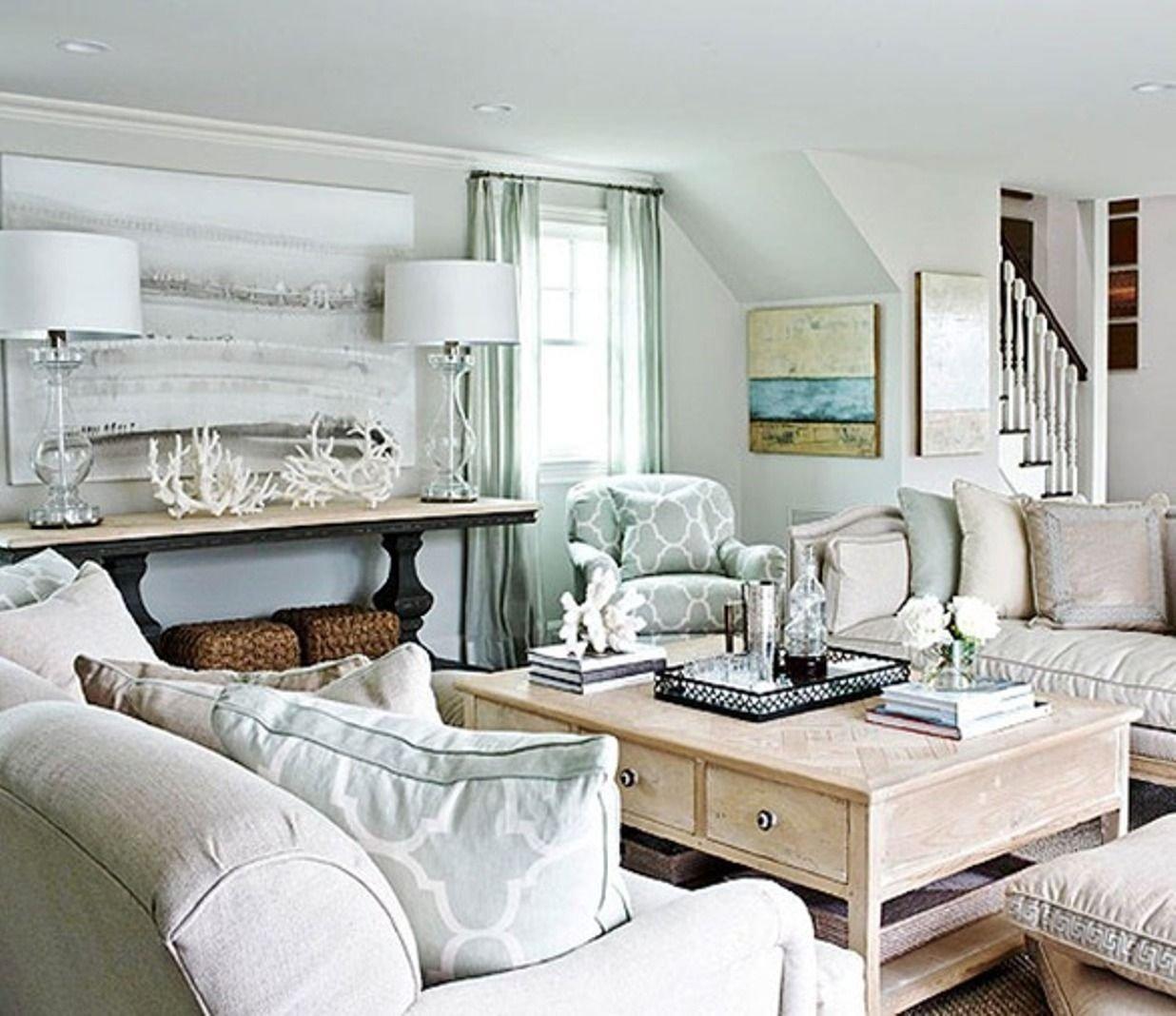 10 Fashionable Beach Themed Living Room Ideas coastal light blue and neutral beach house living room beach house 1 2021