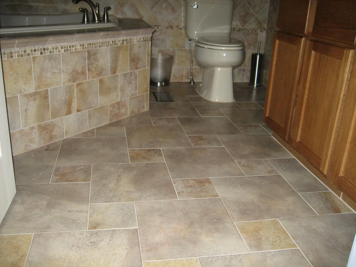 10 Wonderful Tile Flooring Ideas For Bathroom completed porcelain tile floor with a pinwheel pattern layout 2021