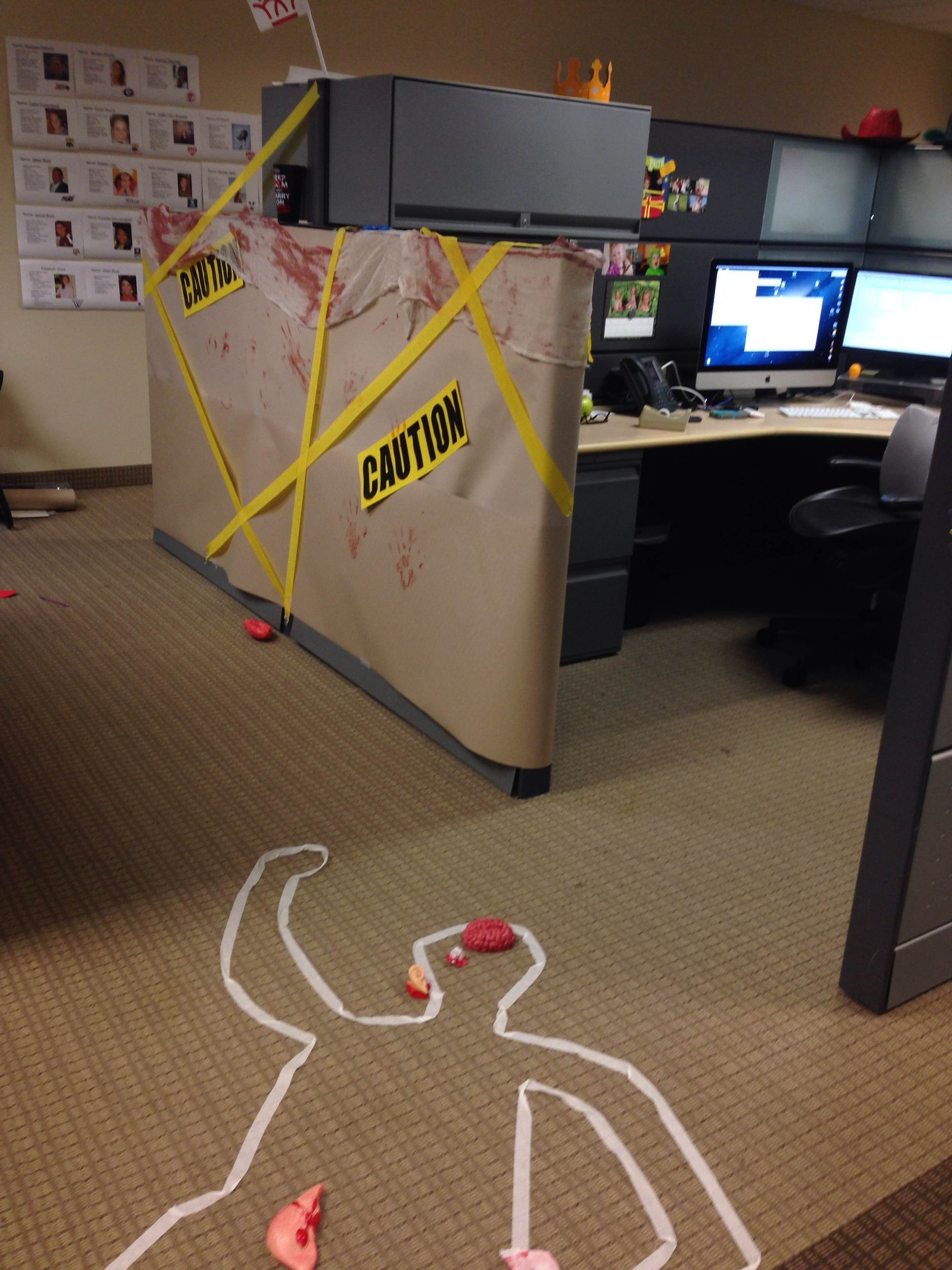 10 Pretty Halloween Ideas For The Office cube decorating contest in the office happy halloween crime scene 2 2020