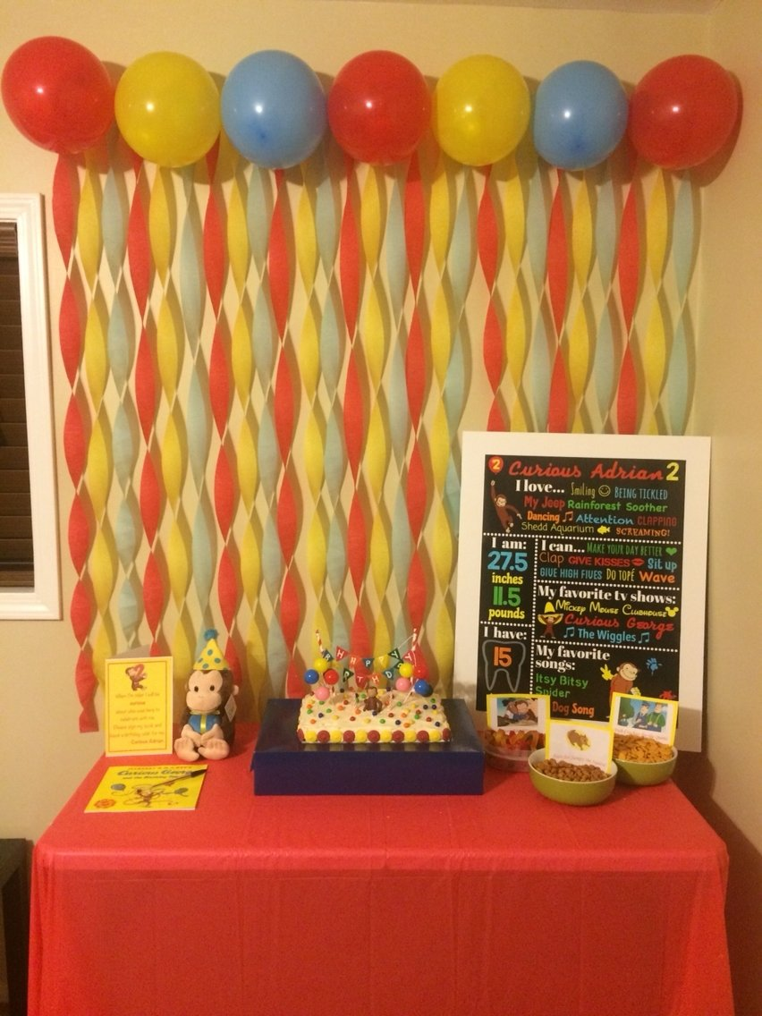 curious george birthday party cake table! | curious adrian is
