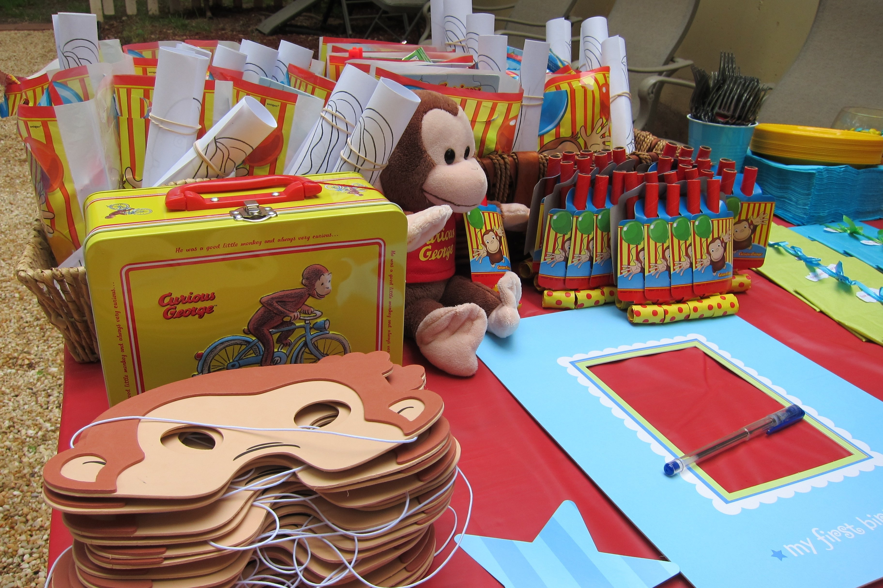 curious george decorations/party favors. and a frame for everyone to
