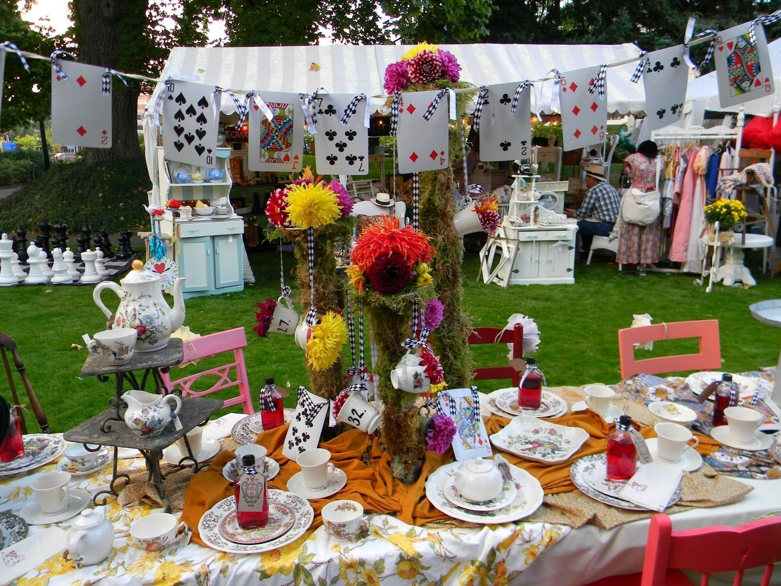decor for mad hatter's tea party: chess pieces and cards. also