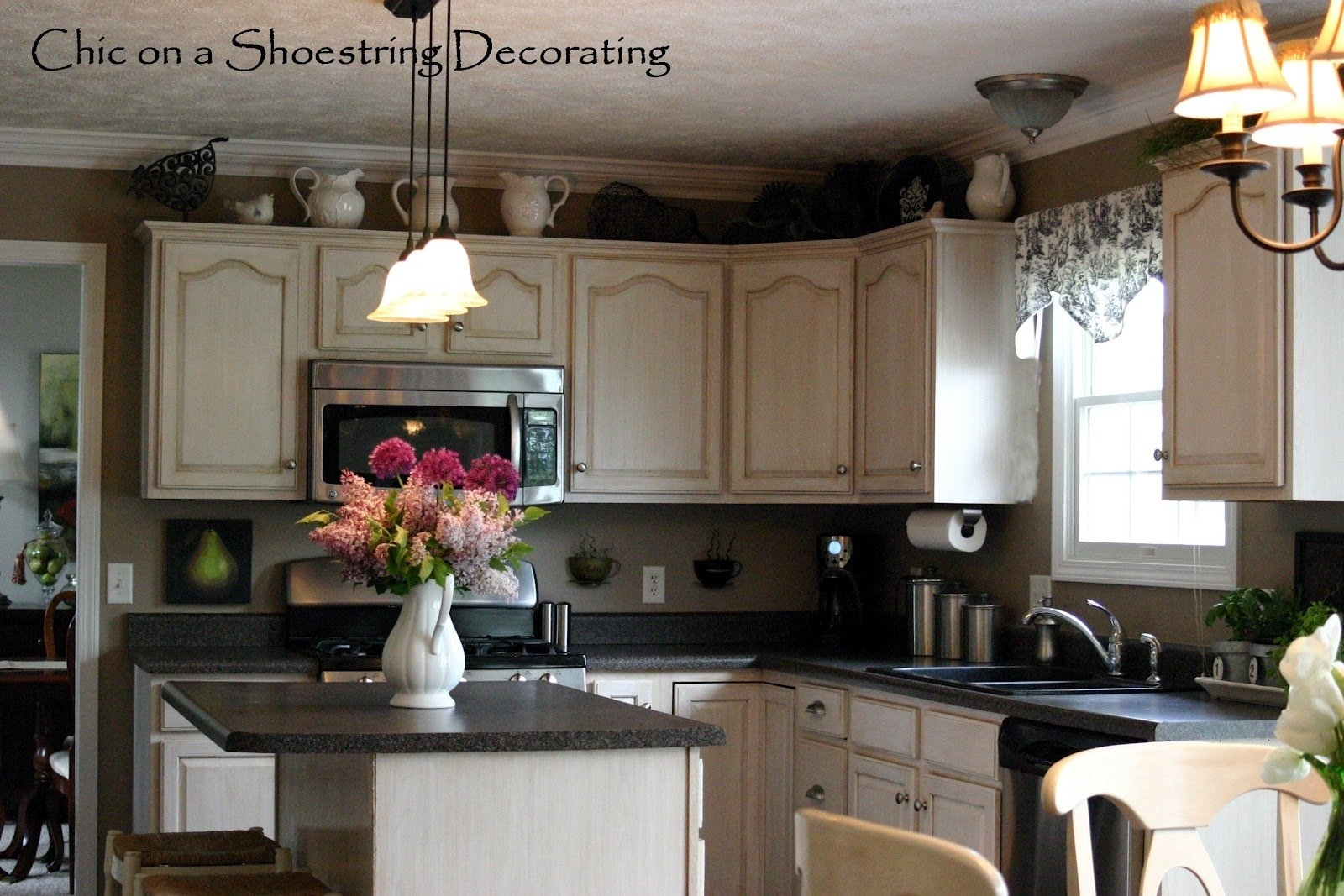 10 Lovely Decorating Ideas For Above Kitchen Cabinets decor for tops of kitchen cabinets best home decoration world class 2021