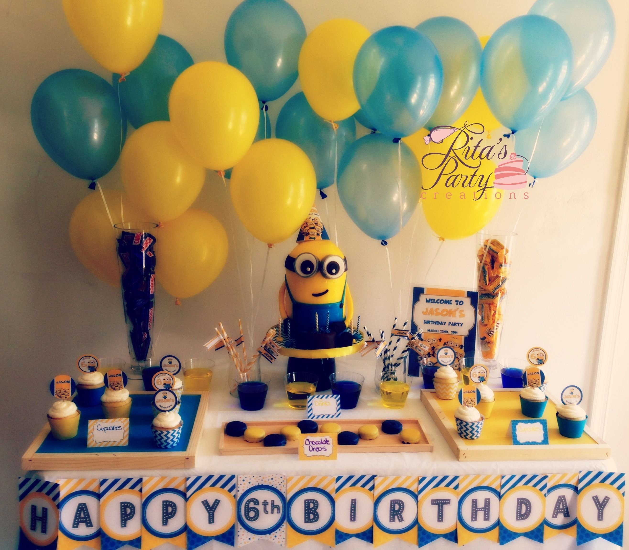 despicable me party table for a 6 year old boy. birthday cake in