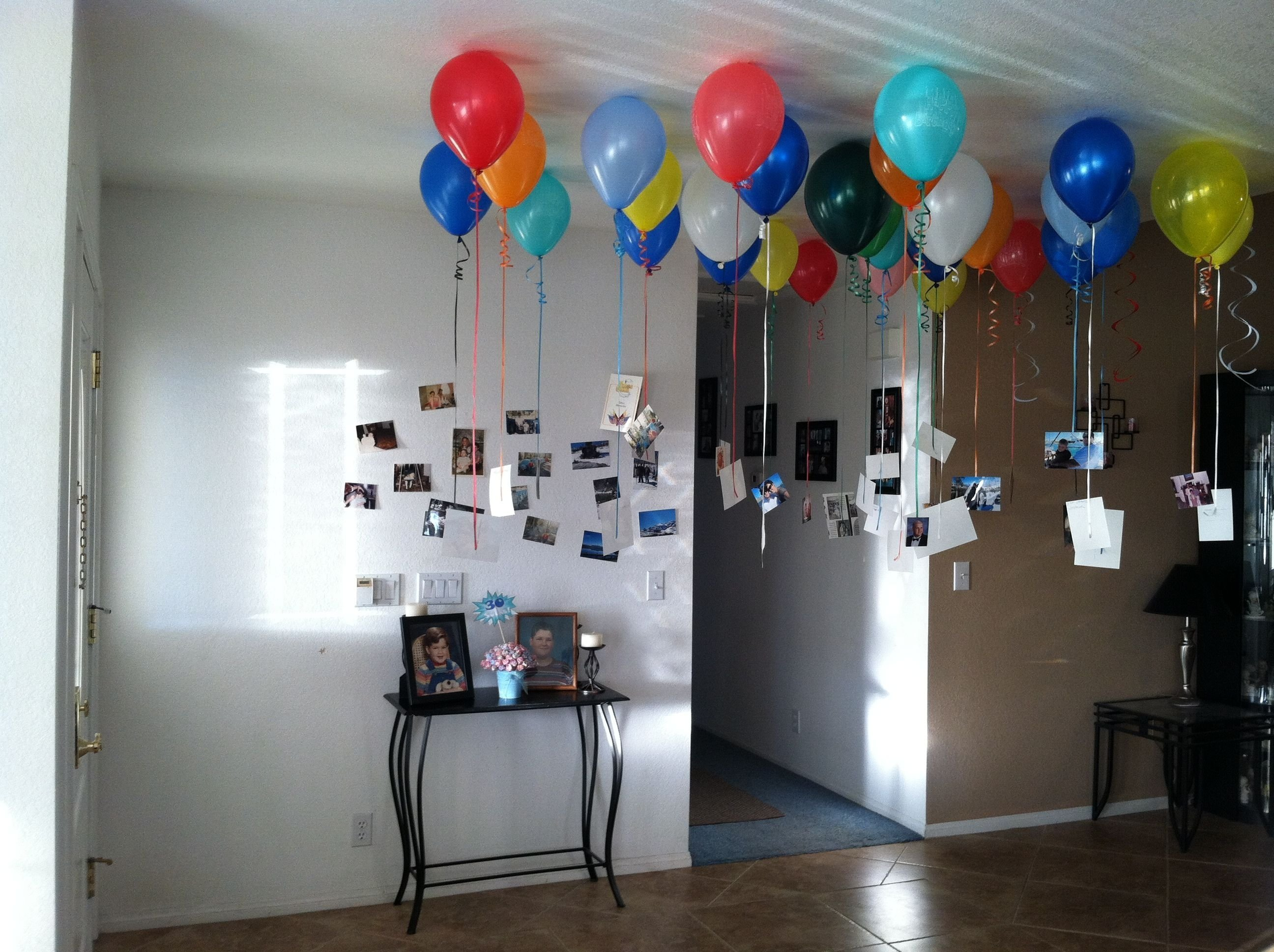 did this in my entry way for husbands 30th birthday.30 balloons