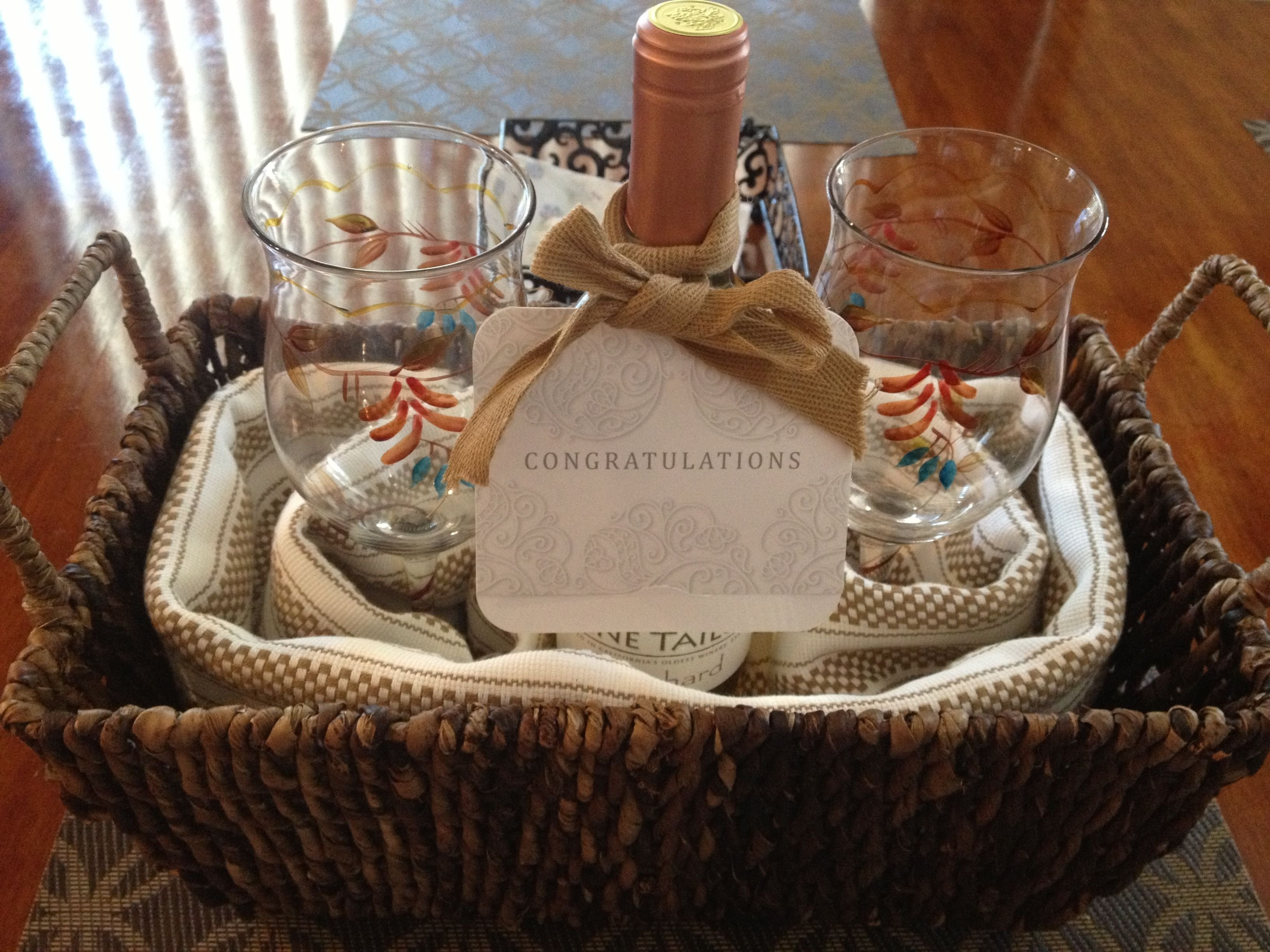 10 Beautiful Housewarming Gifts Ideas For Couples diy house warming gift wicker basket kitchen towels 2 wine 2020