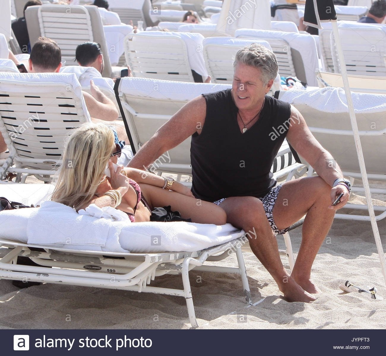 donny deutsch and a mystery woman. donny deutsch advertising stock