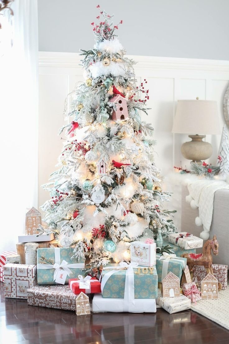 10 Elegant Flocked Christmas Tree Decorating Ideas flocked christmas tree blue and red christmas theme christmas tree