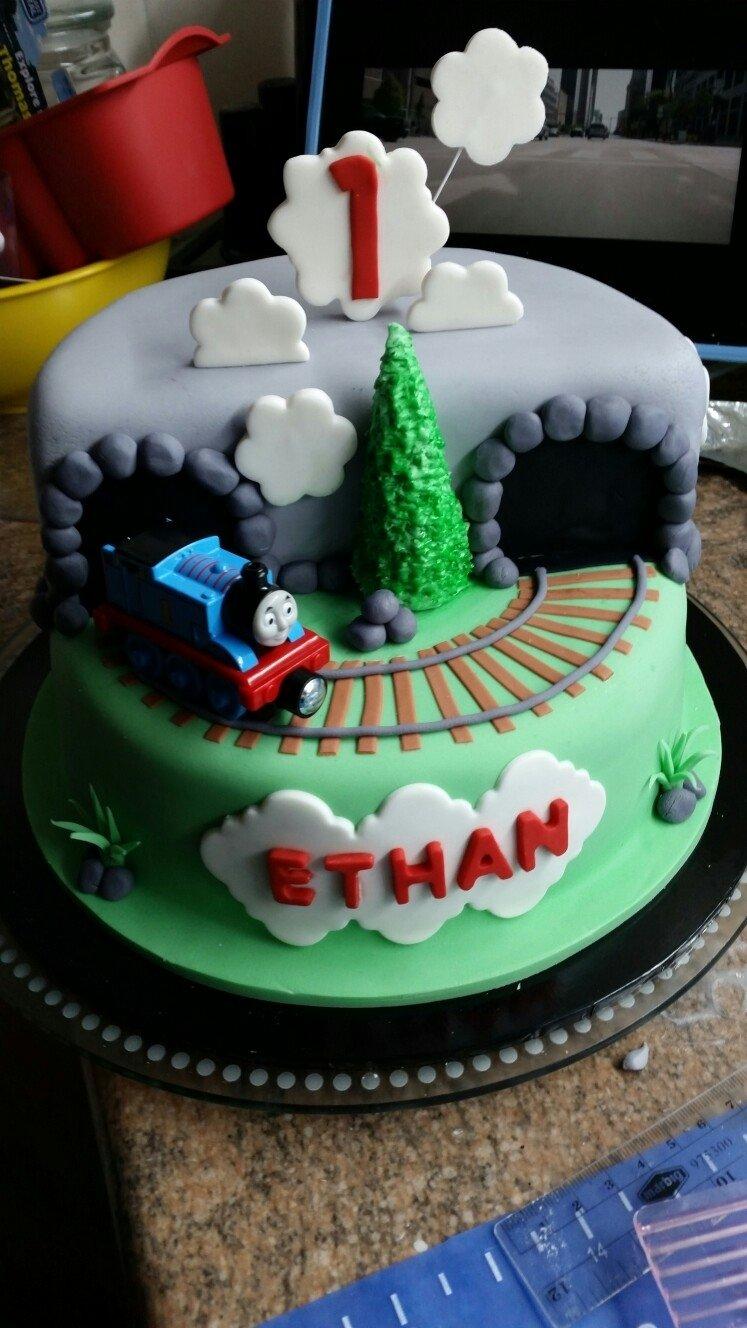 10 Amazing Thomas The Train Cakes Ideas fondant thomas the train engine birthday cake with track and tunnel 1 2021