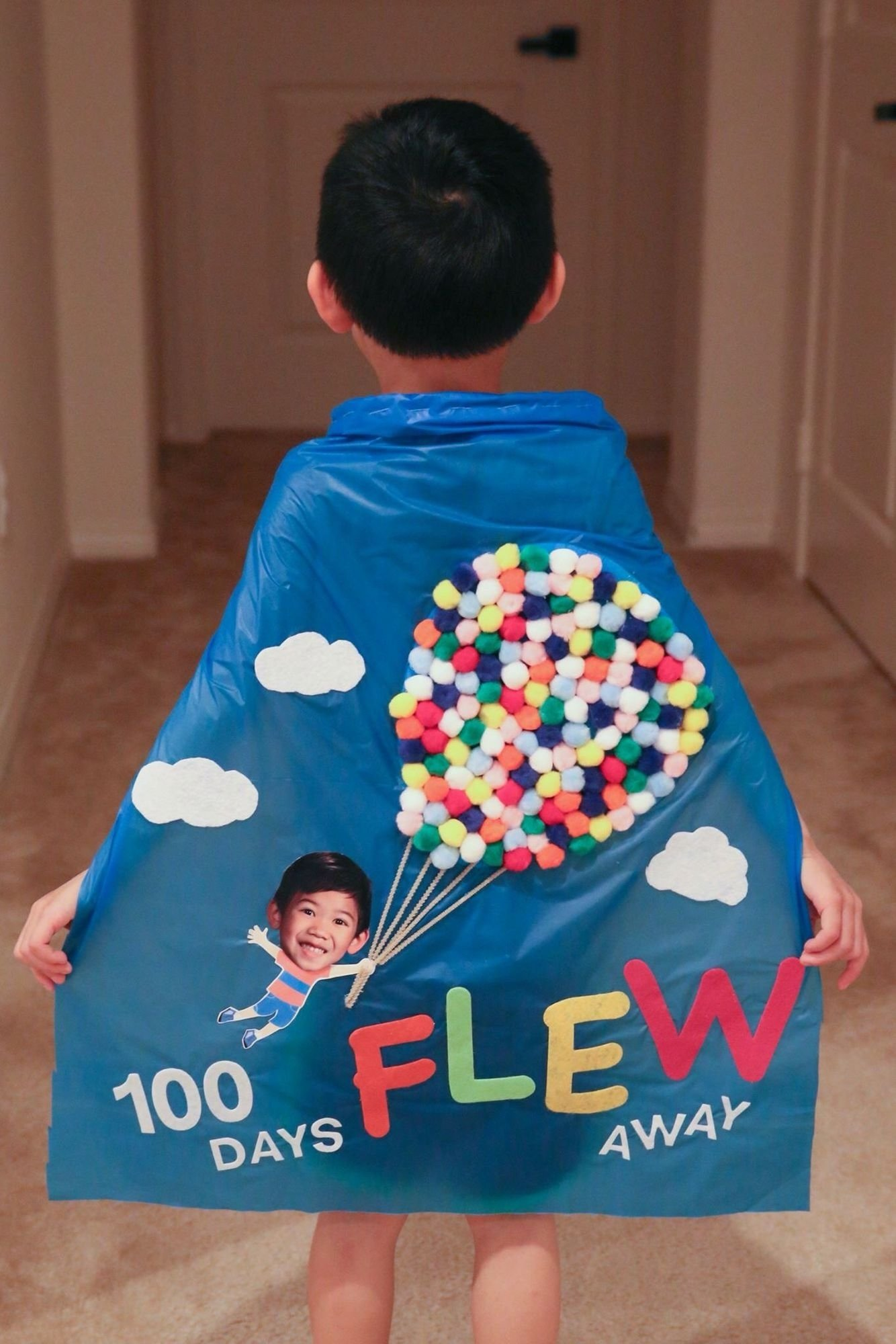 from up, up & away. 100 days of school cape made from pom poms