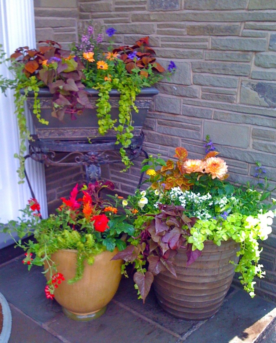 10 Fashionable Flower Pot Ideas For Front Porch front porch awesome flowers pots design with brown round and square 1 2021