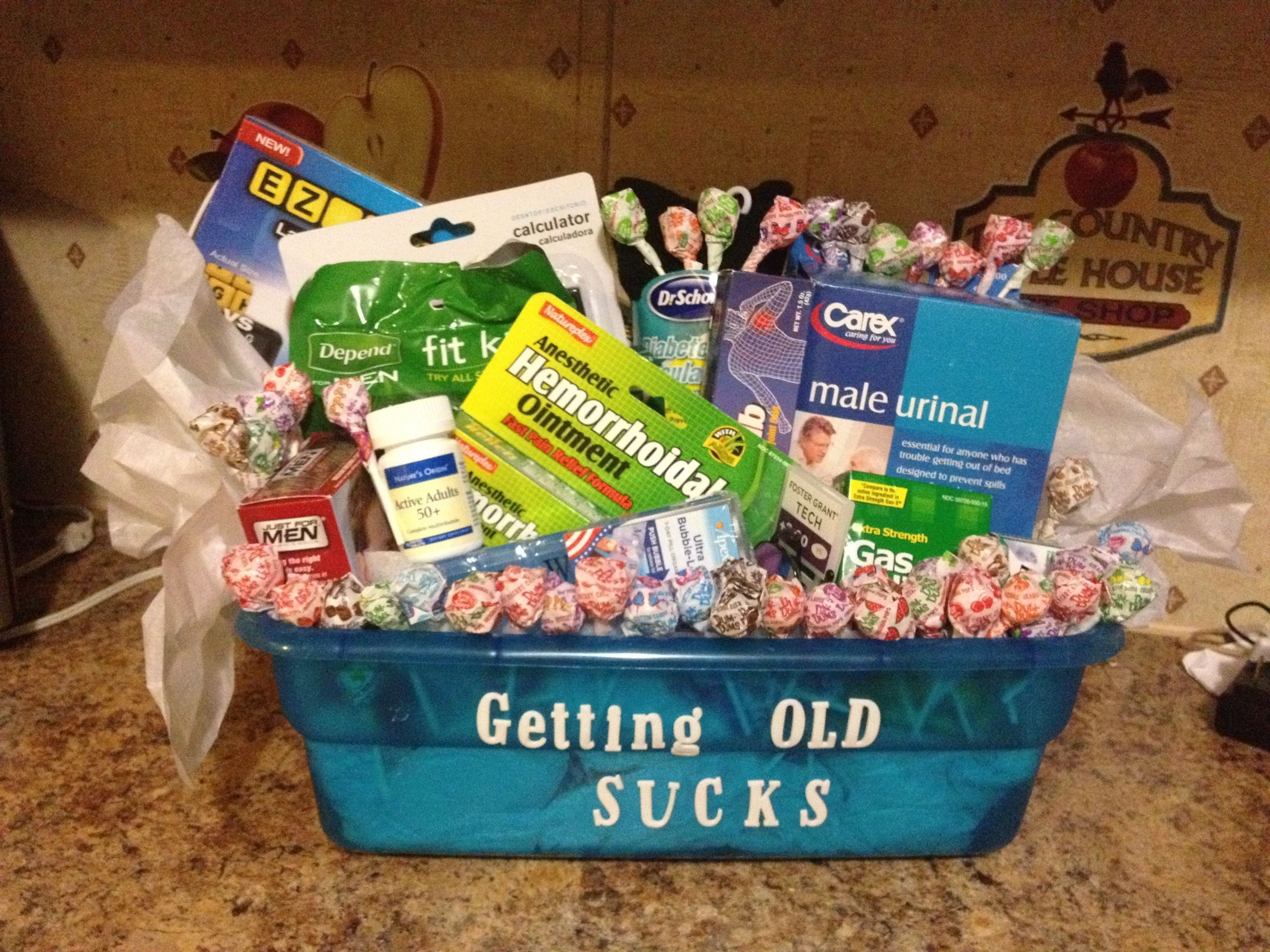 gag gift i made for my father n laws 50th birthday! get a basket