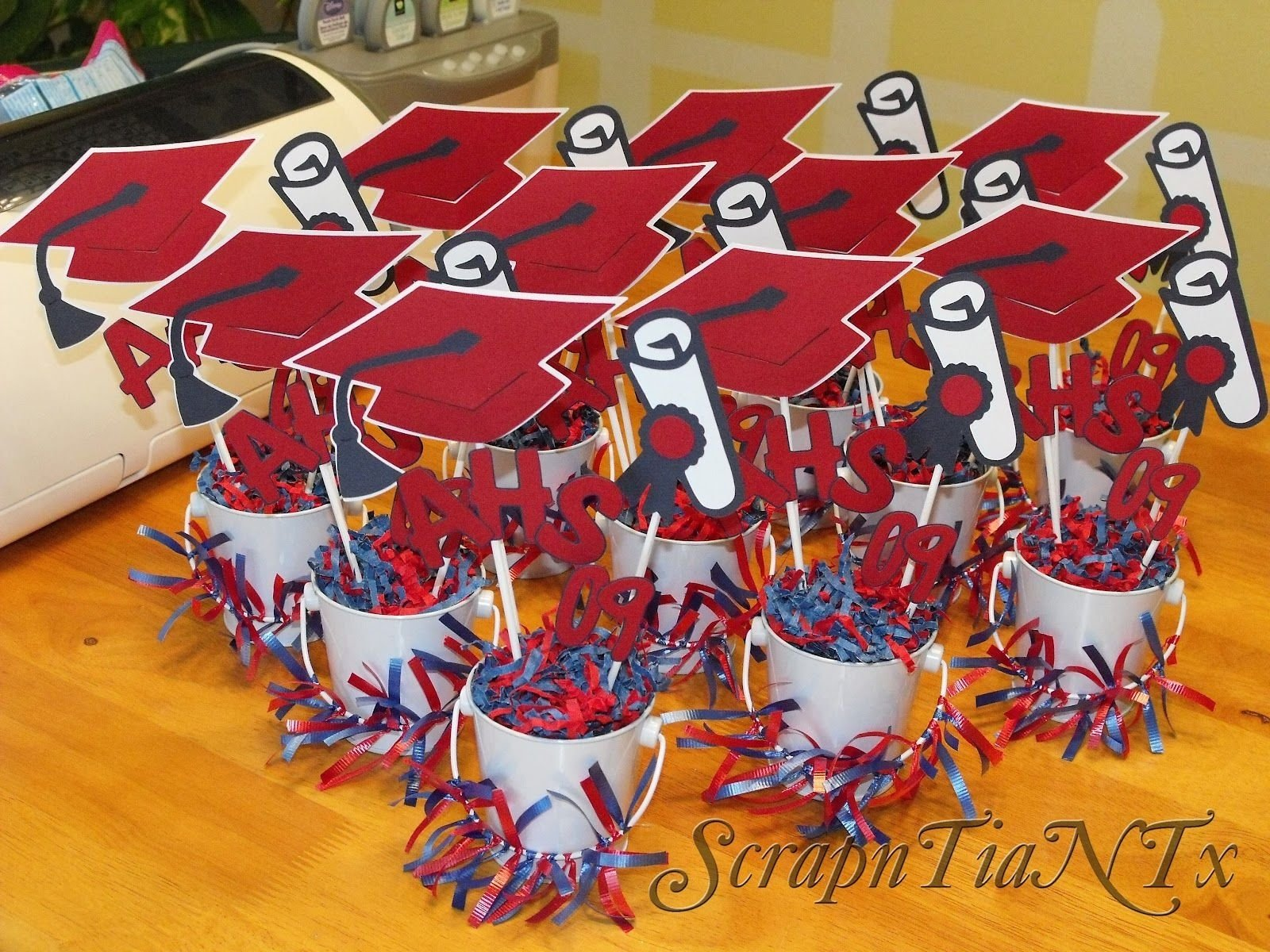 10 Most Popular Graduation Party Table Centerpiece Ideas graduation centerpieces pails with cap and year decorations